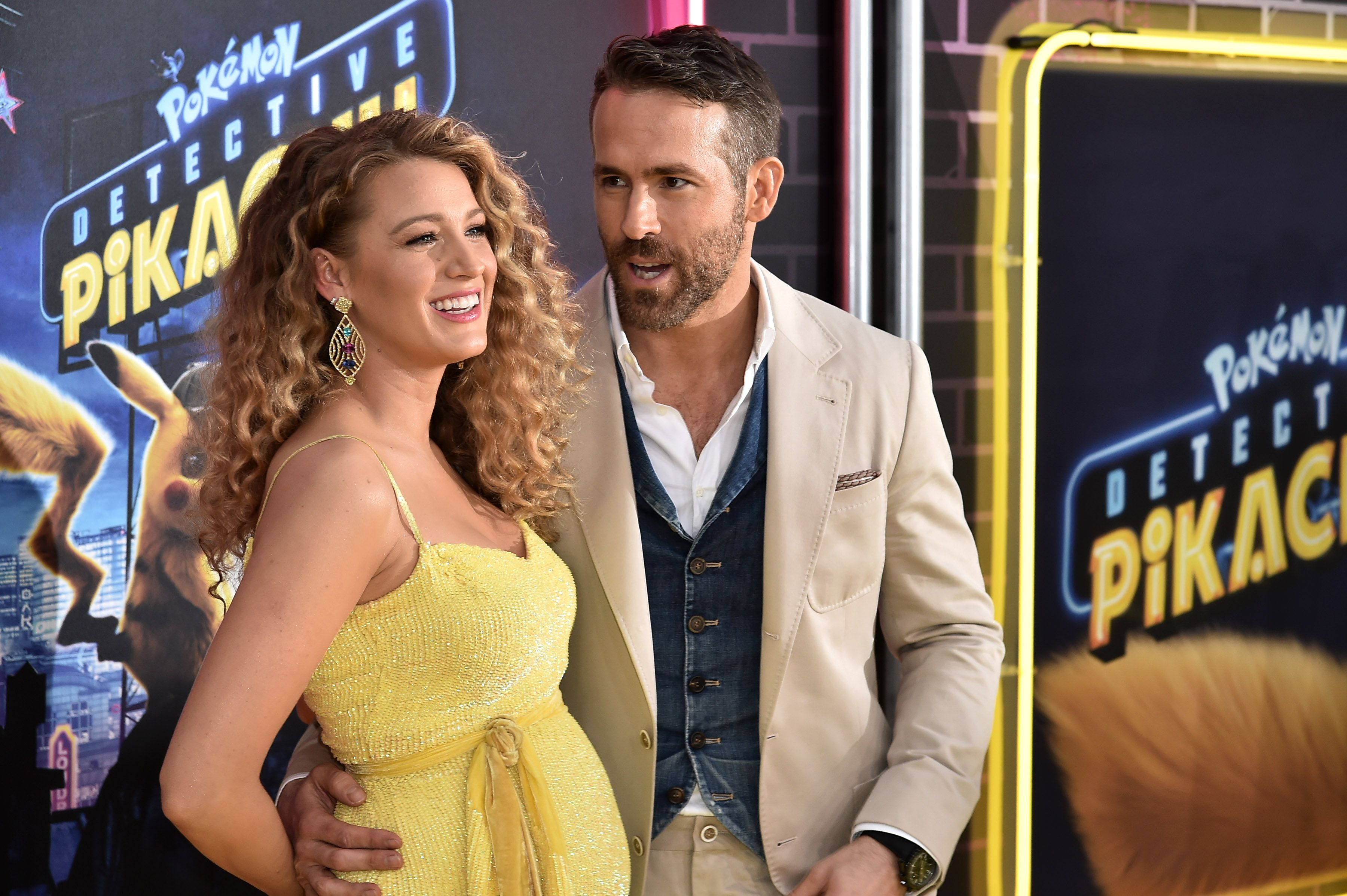 Blake Lively and Ryan Reynolds pose for a photo.