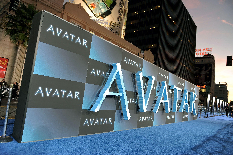 An 'Avatar' billboard is seen behind a blue carpet.