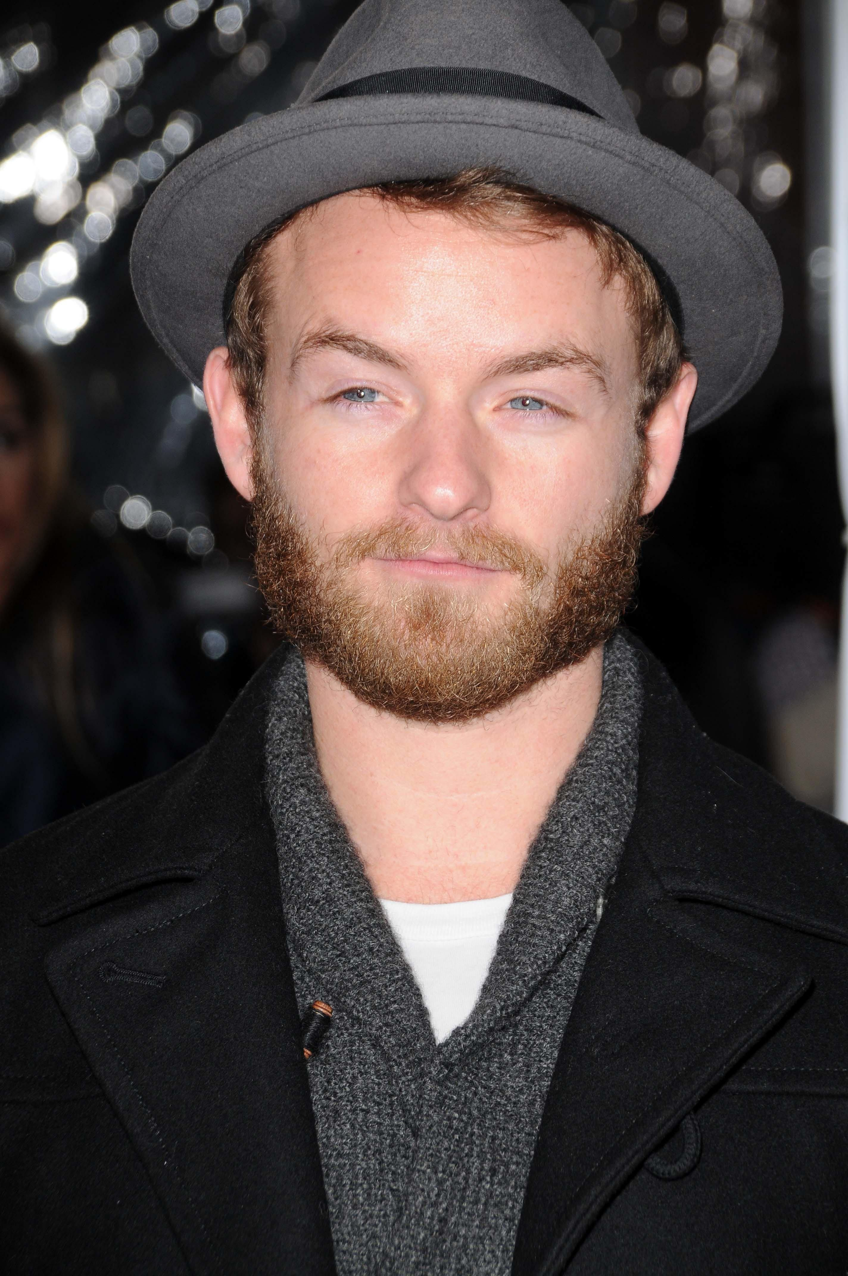 Close-up of Christopher Masterson wearing a coat and fedora.