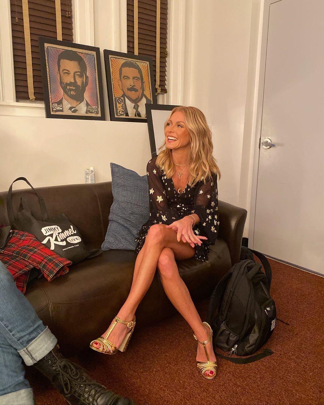 Kelly Ripa leggy and seated