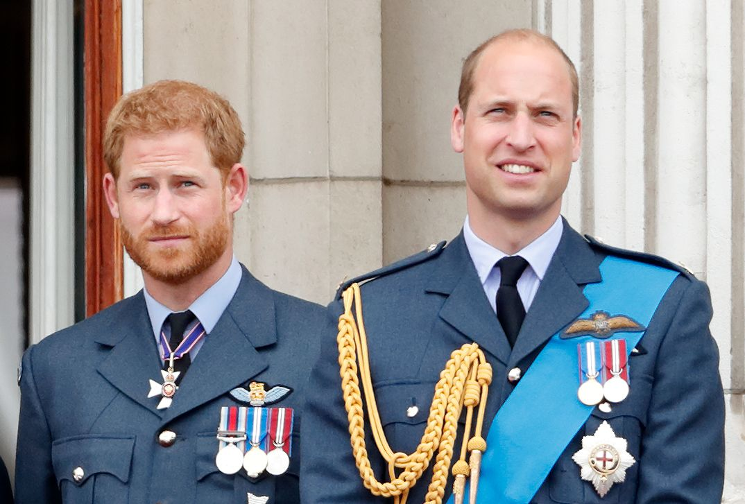 Prince Harry standing next to his older brother Prince William