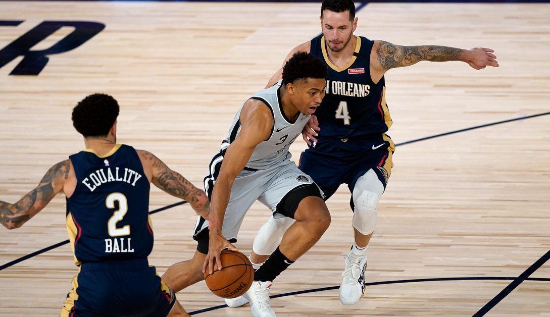 Lonzo Ball and JJ Redick of the New Orleans Pelicans double-team San Antonio Spurs forward Keldon Johnson.