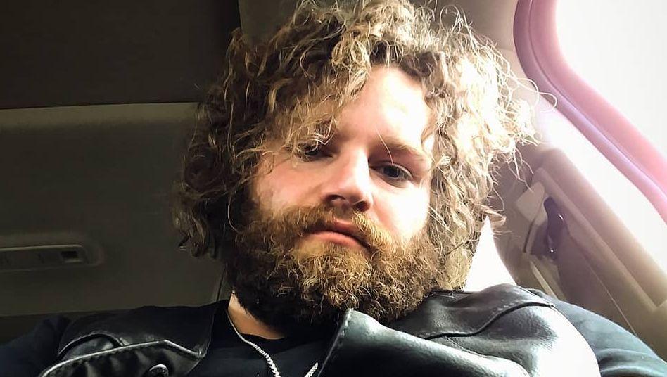 Gabe Brown taking selfie in car