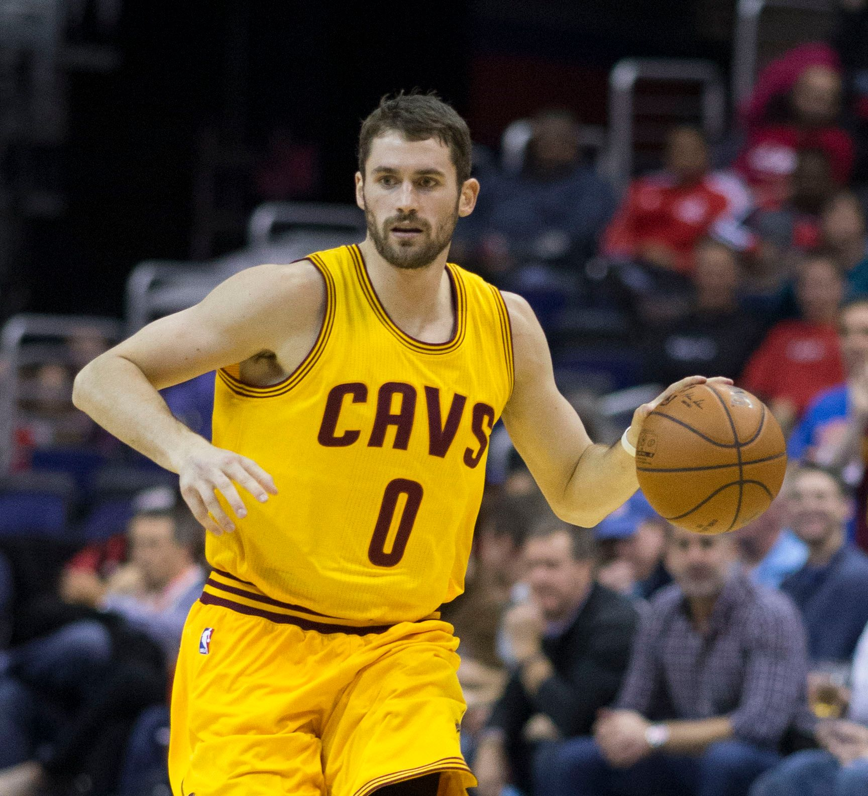 Kevin Love of the Cleveland Cavaliers dribbles the bal down court.