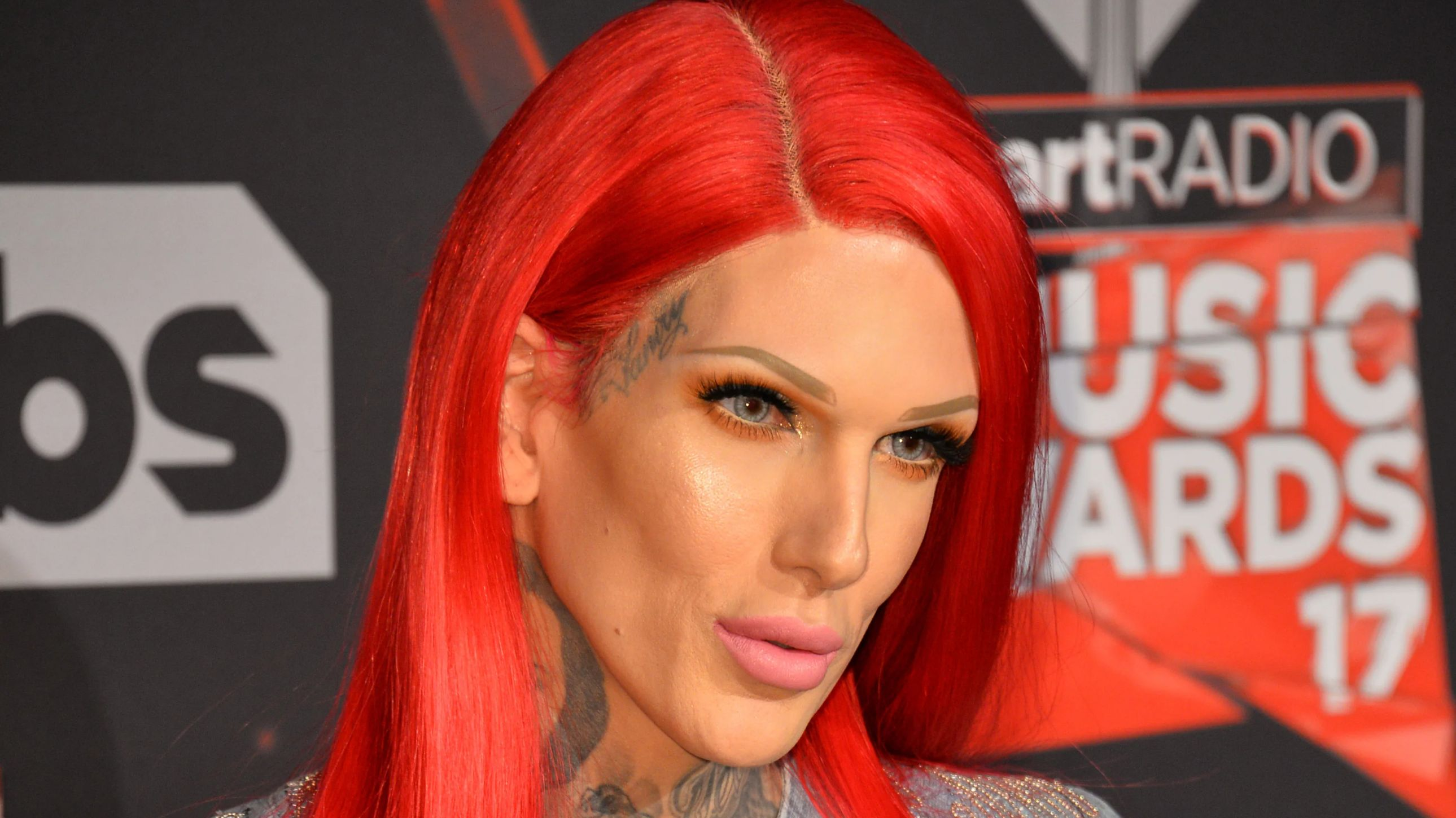 Jeffree Star in a red wig