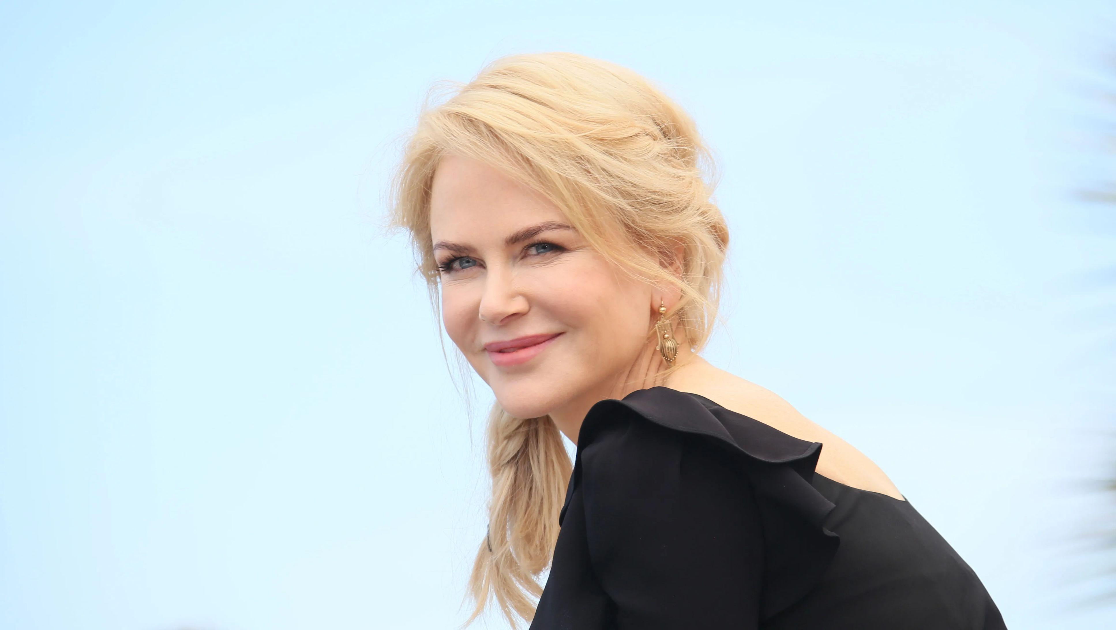 Nicole Kidman with blonde hair and a black dress