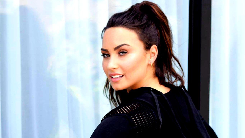 Demi Lovato looks over her shoulder as she advertises her original Fabletics line; October, 2017.