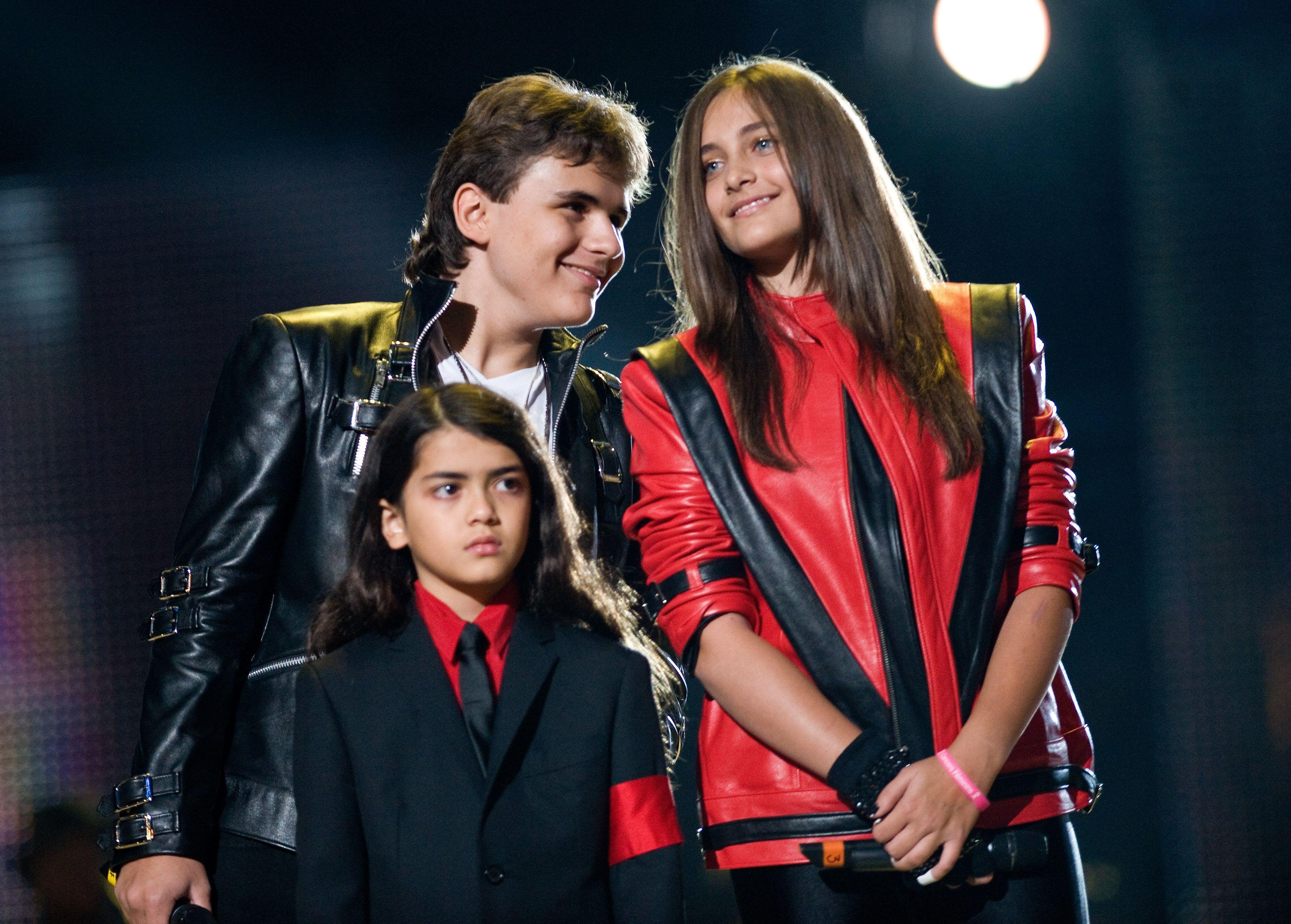 Blanket Jackson with his siblings