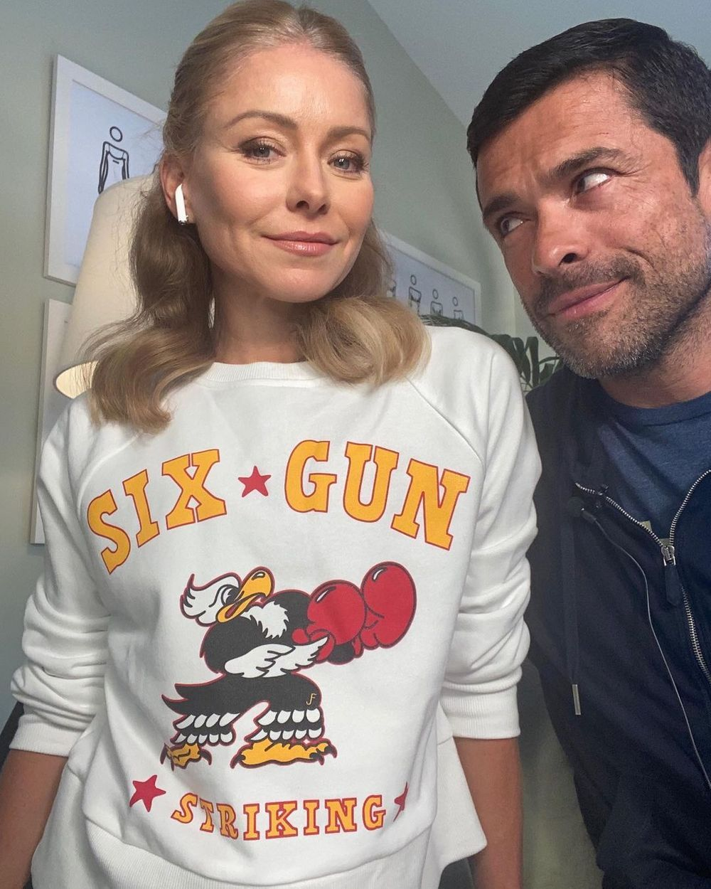 Kelly Ripa in a sweater with husband Mark