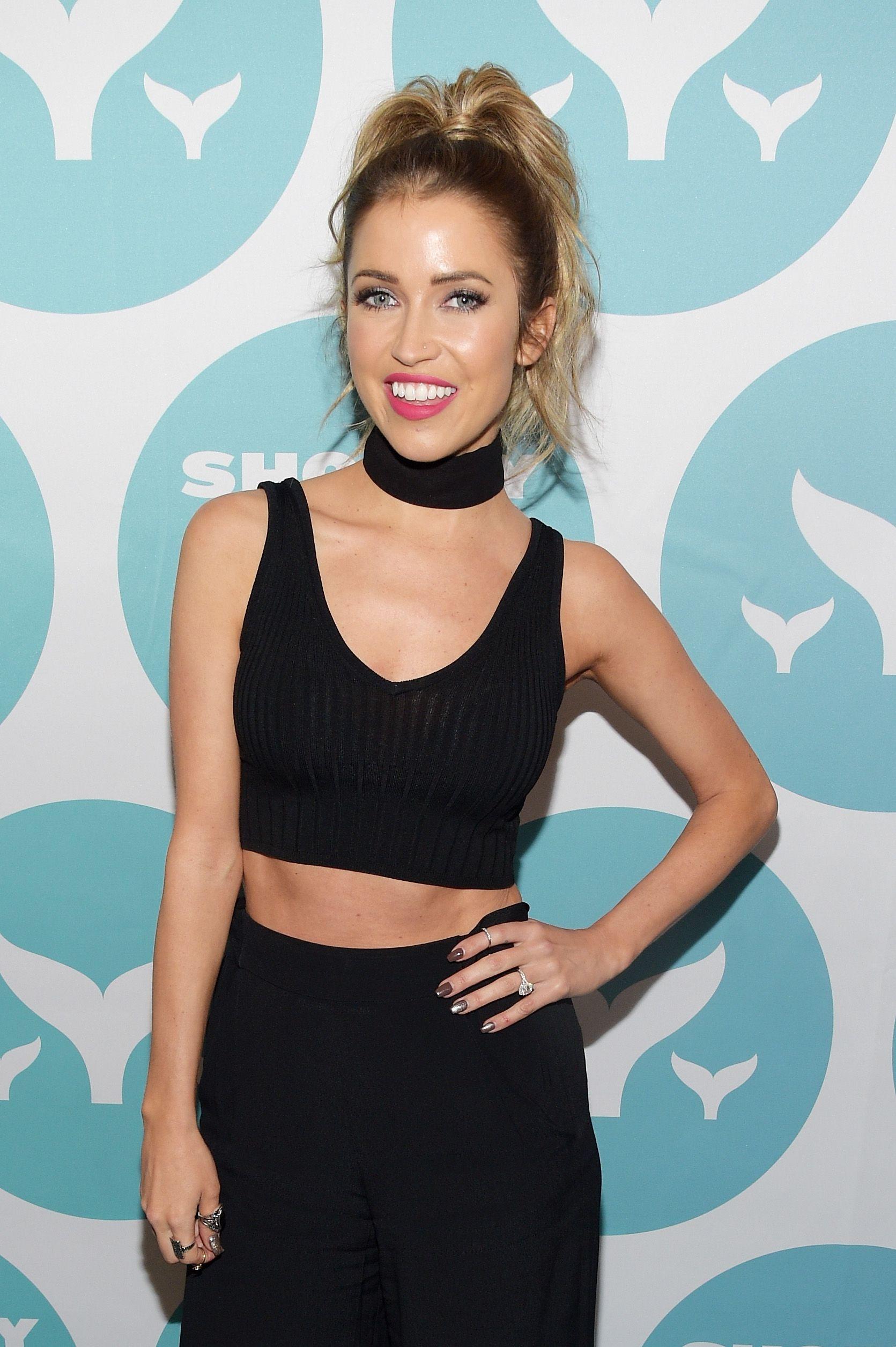 Kaitlyn Bristowe wears a black crop top and matching choker.