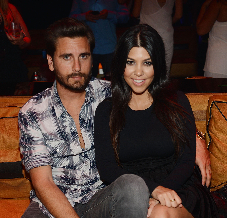 Scott Disick and Kourtney Kardashian sitting together.