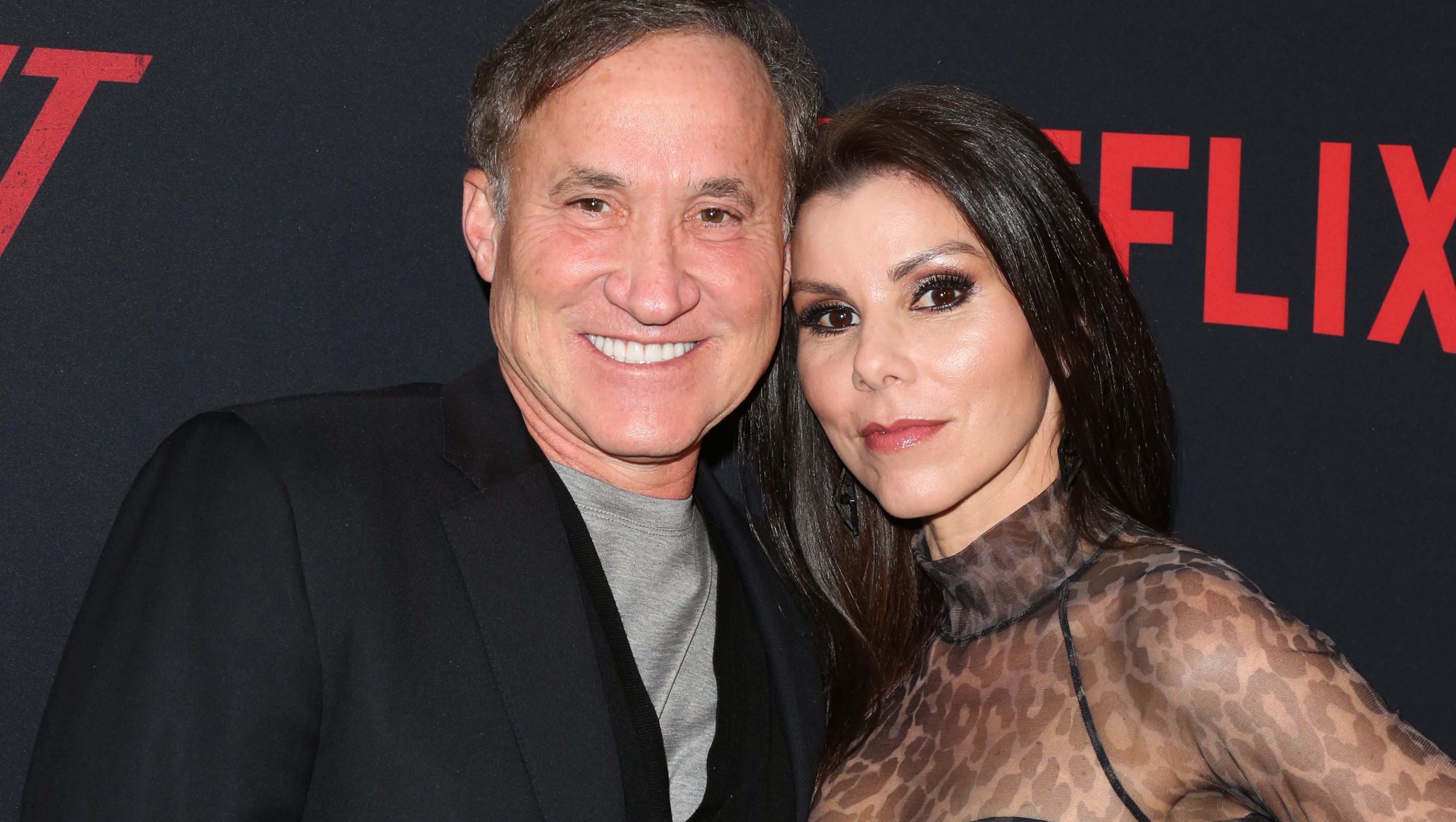 Dr. Terry Dubrow and Heather Dubrow attends a Netflix premiere.