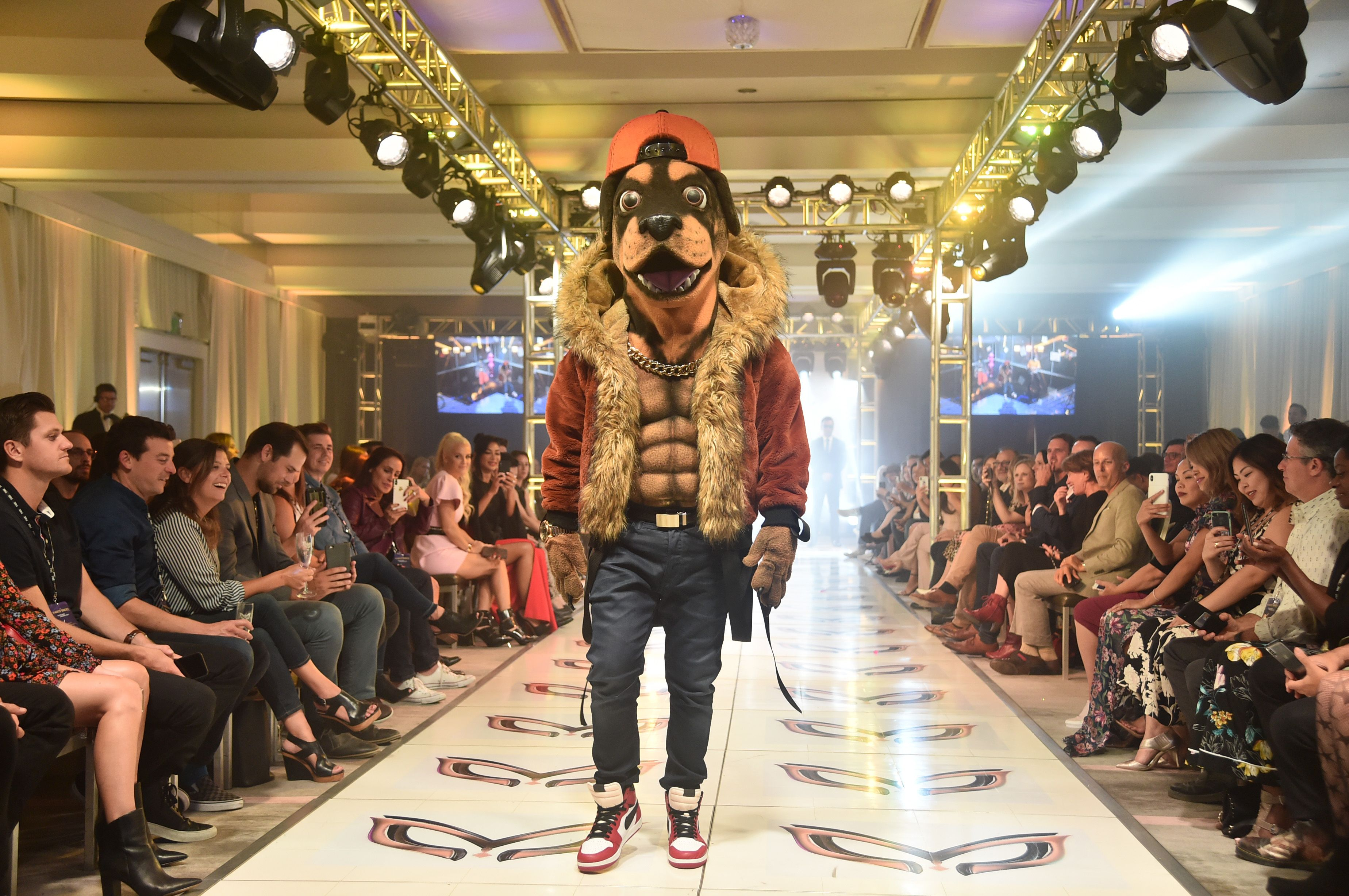 The Masked Singer's Rottweiler on a runway.