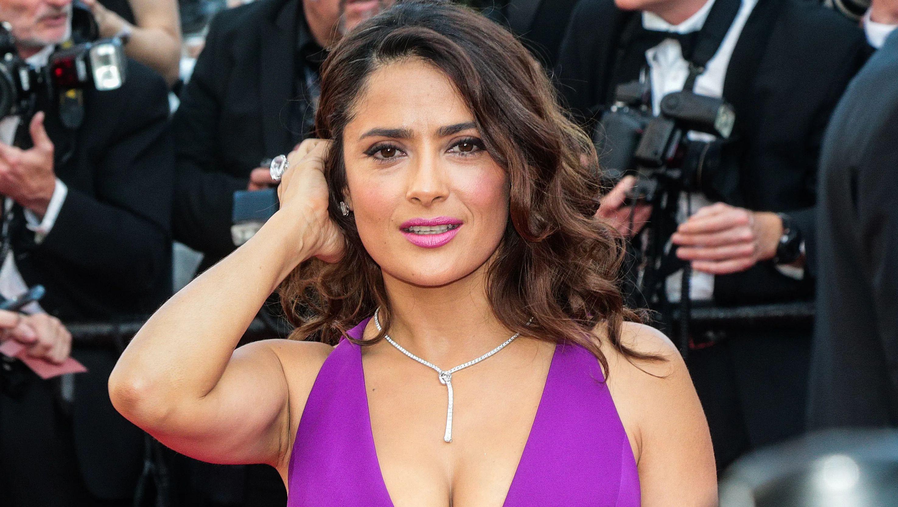 Salma Hayek on red carpet in purple dress