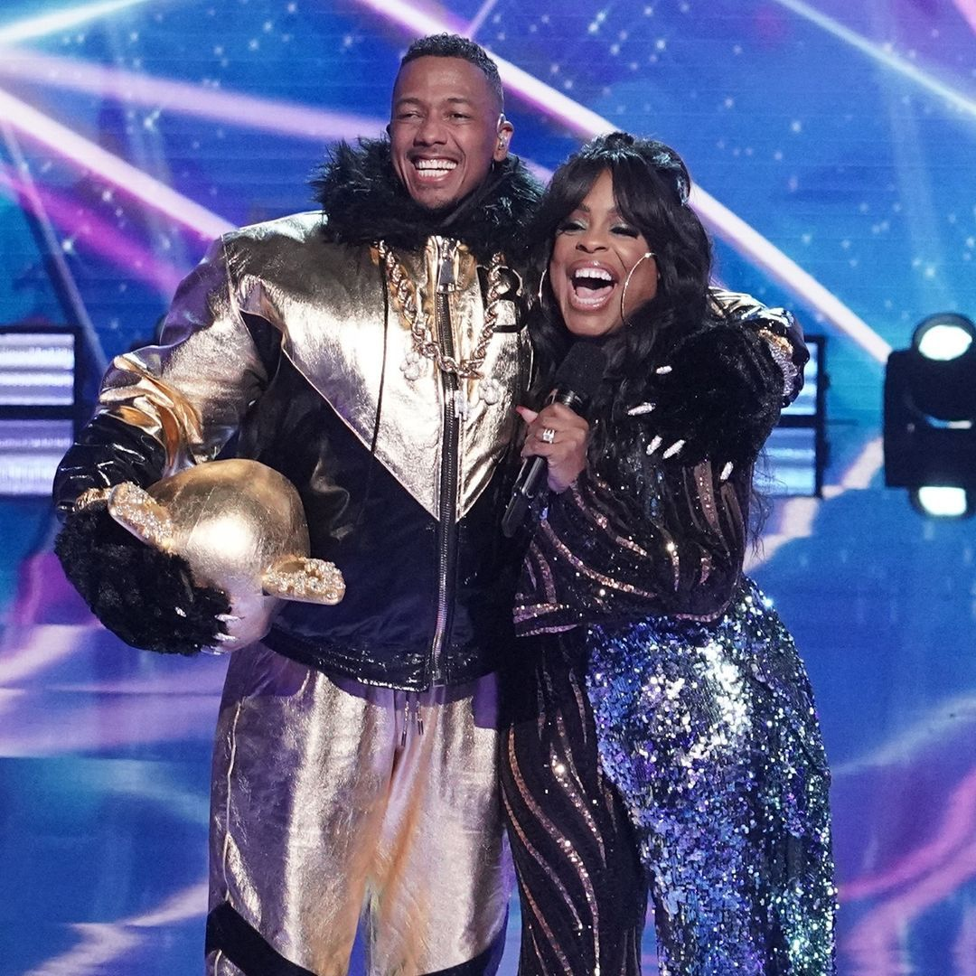 """Host Nick Cannon and Niecy Nash celebrate on """"The Masked Singer"""" stage during his season 5 unmasking as the Bulldog."""