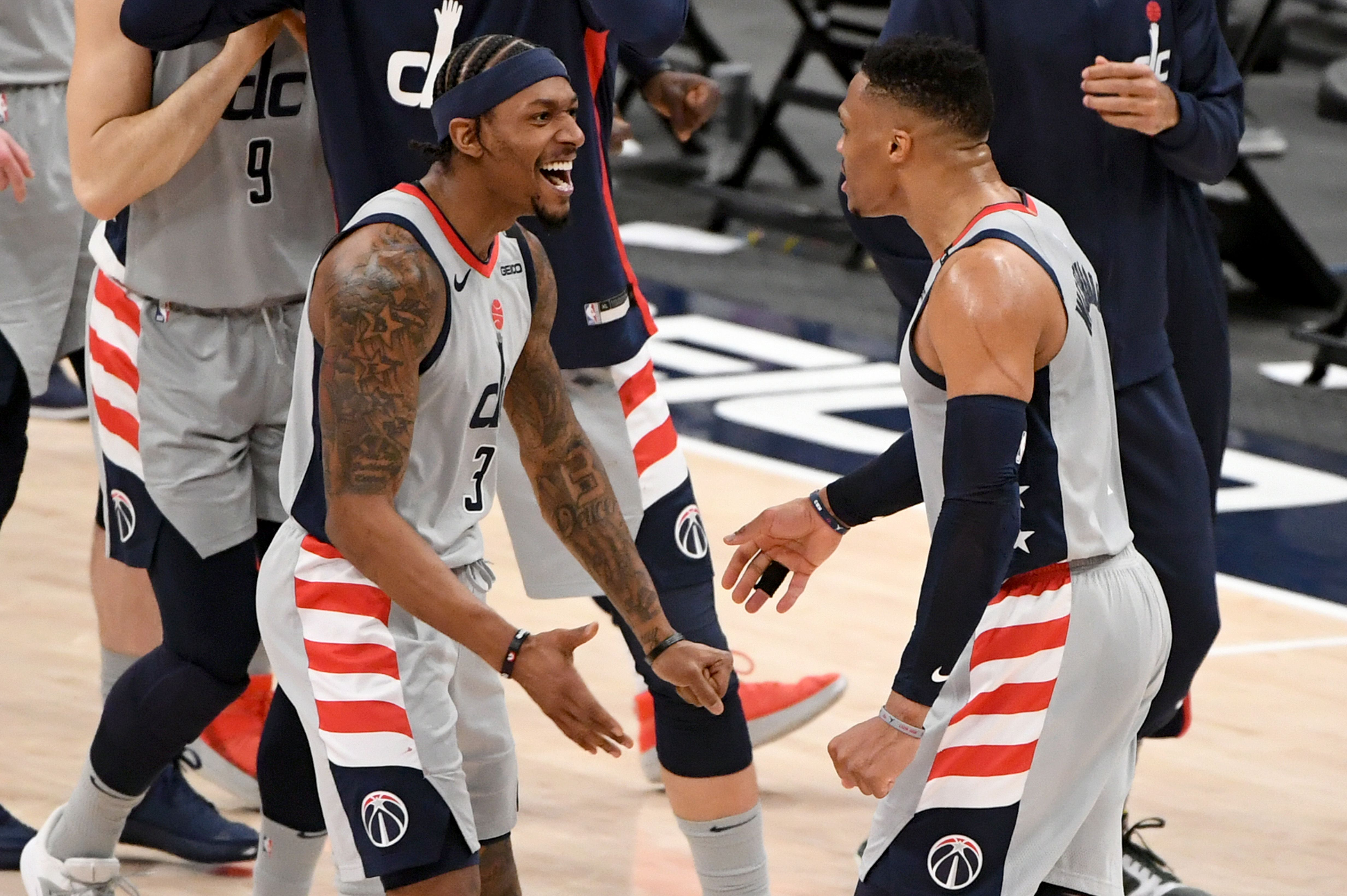 Bradley Beal and Russell Westbrook shake hands after Wizards win the game