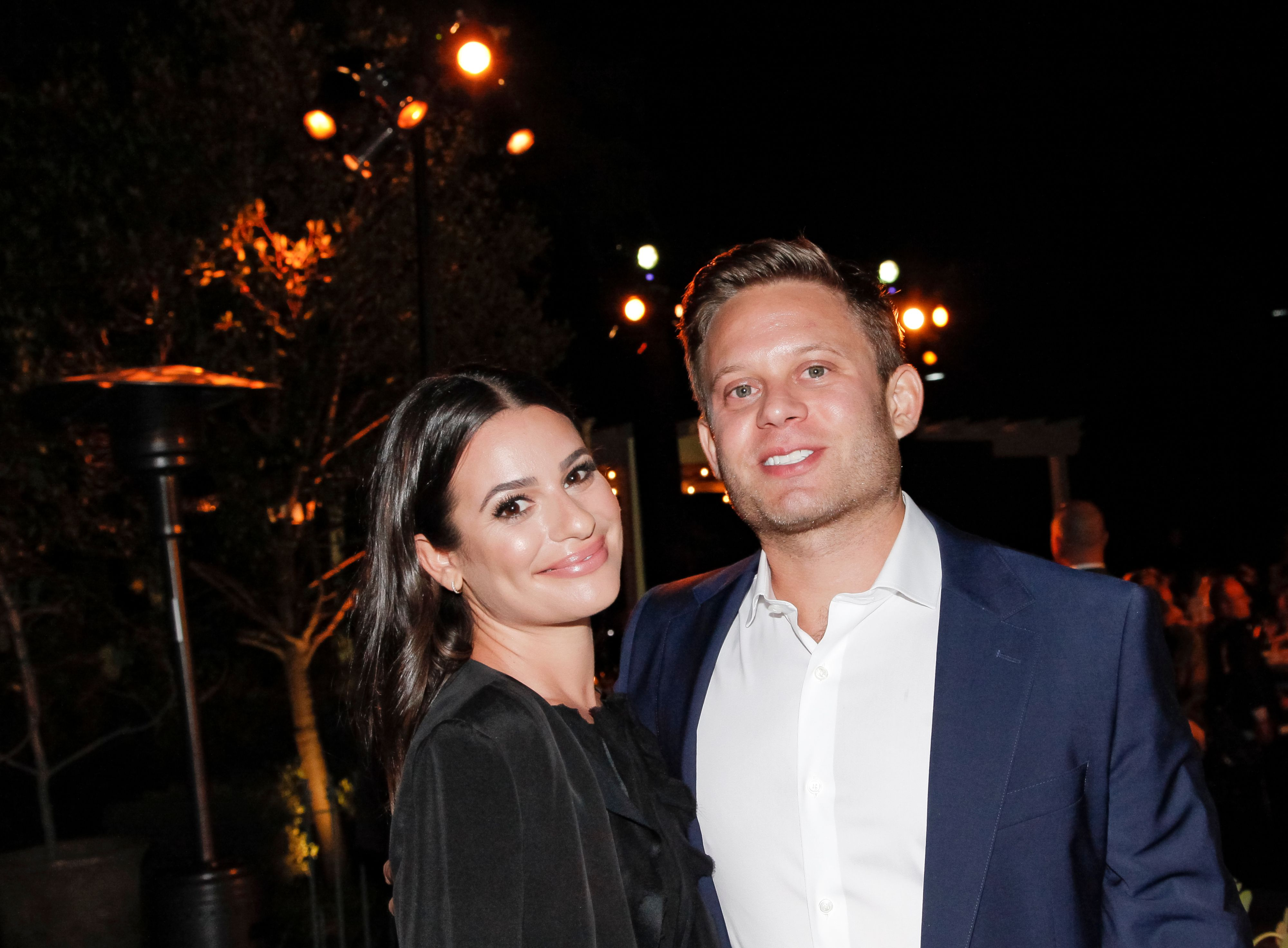 Lea Michele standing with her husband, Zandy Reich.
