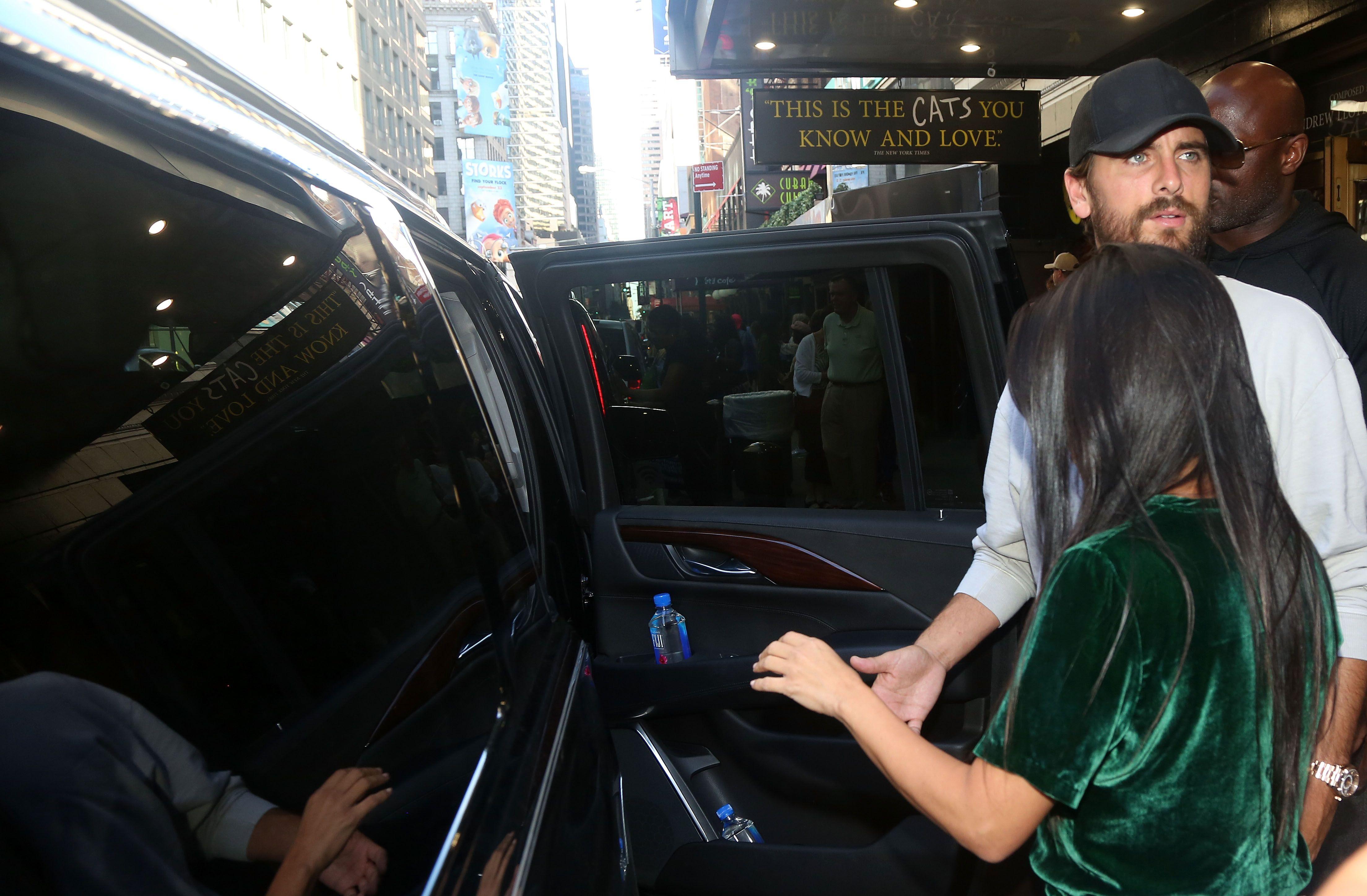 Scott Disick getting in a limo with Kourtney Kardashian