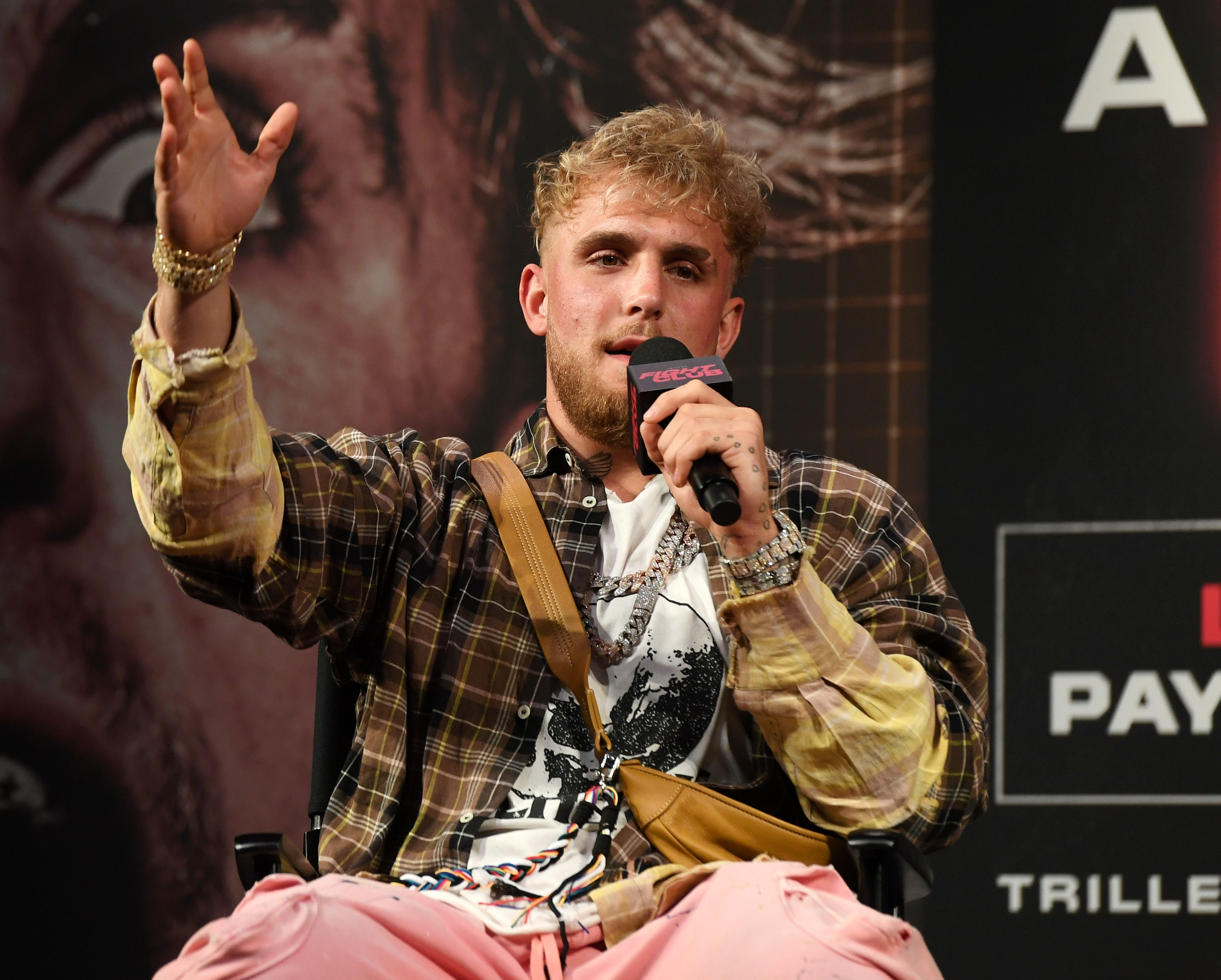 Jake Paul speaks at an event promoting his fight.
