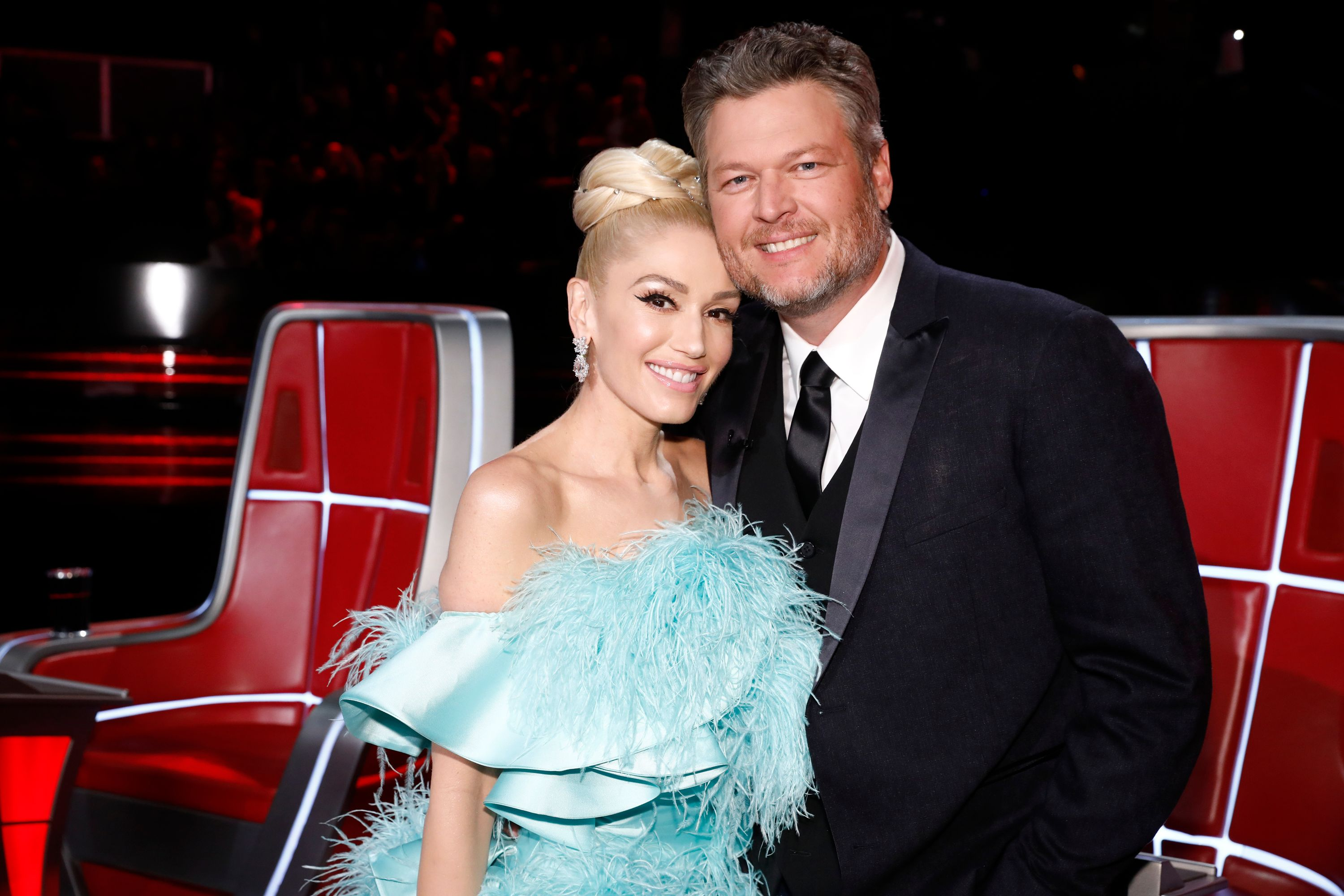 Gwen Stefani (left) poses with Blake Shelton (right) on The Voice set