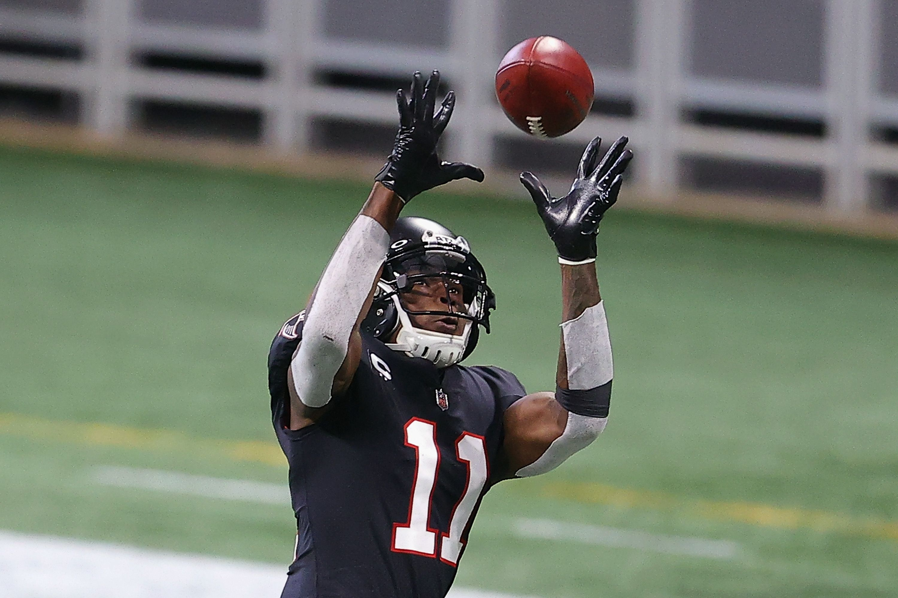 Julio Jones catches a pass in an NFL game.