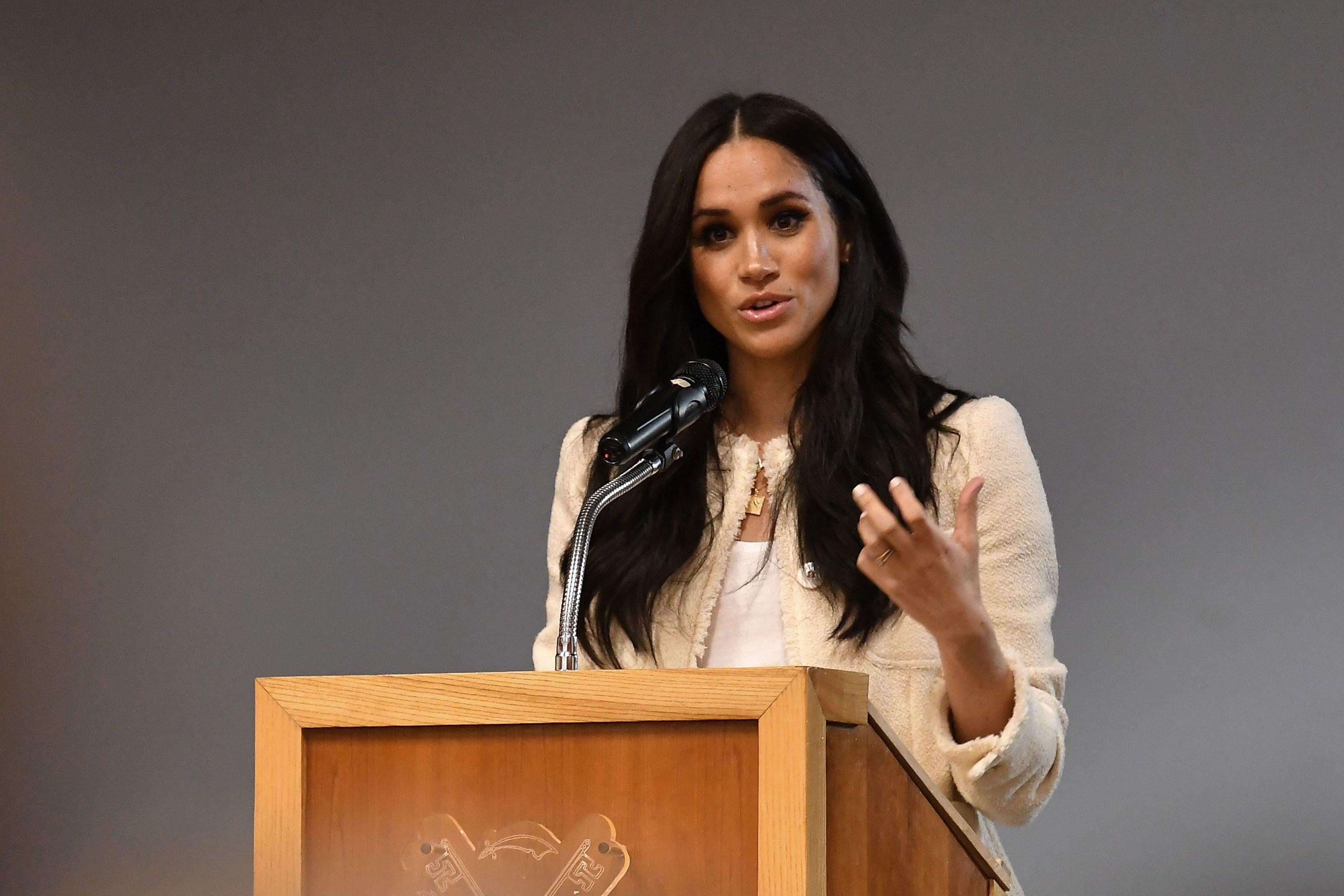Meghan Markle giving a speech at a podium