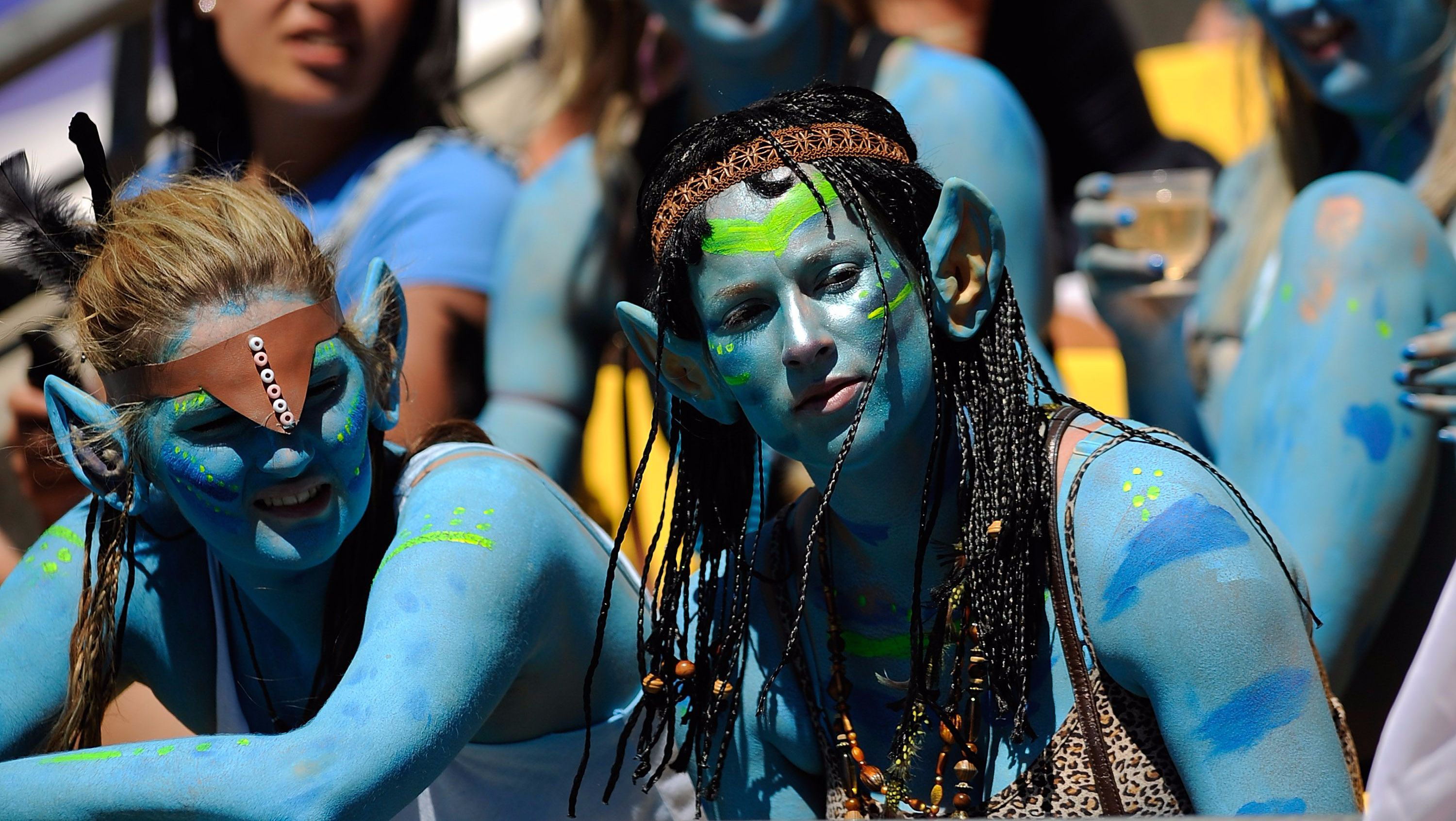Avatar creatures are seen in blue paint and dreadlocks.