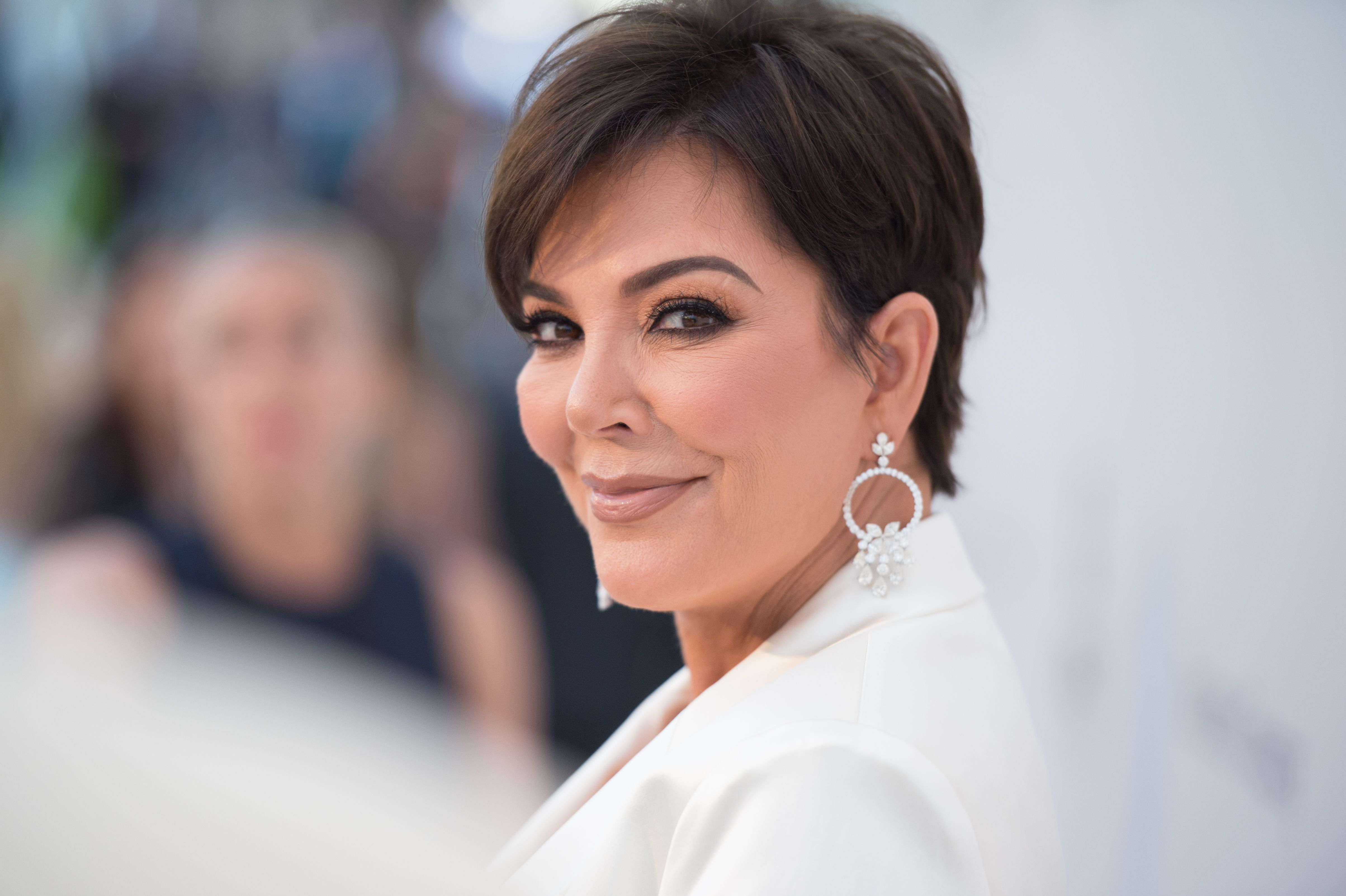 Kris Jenner in a white jacket