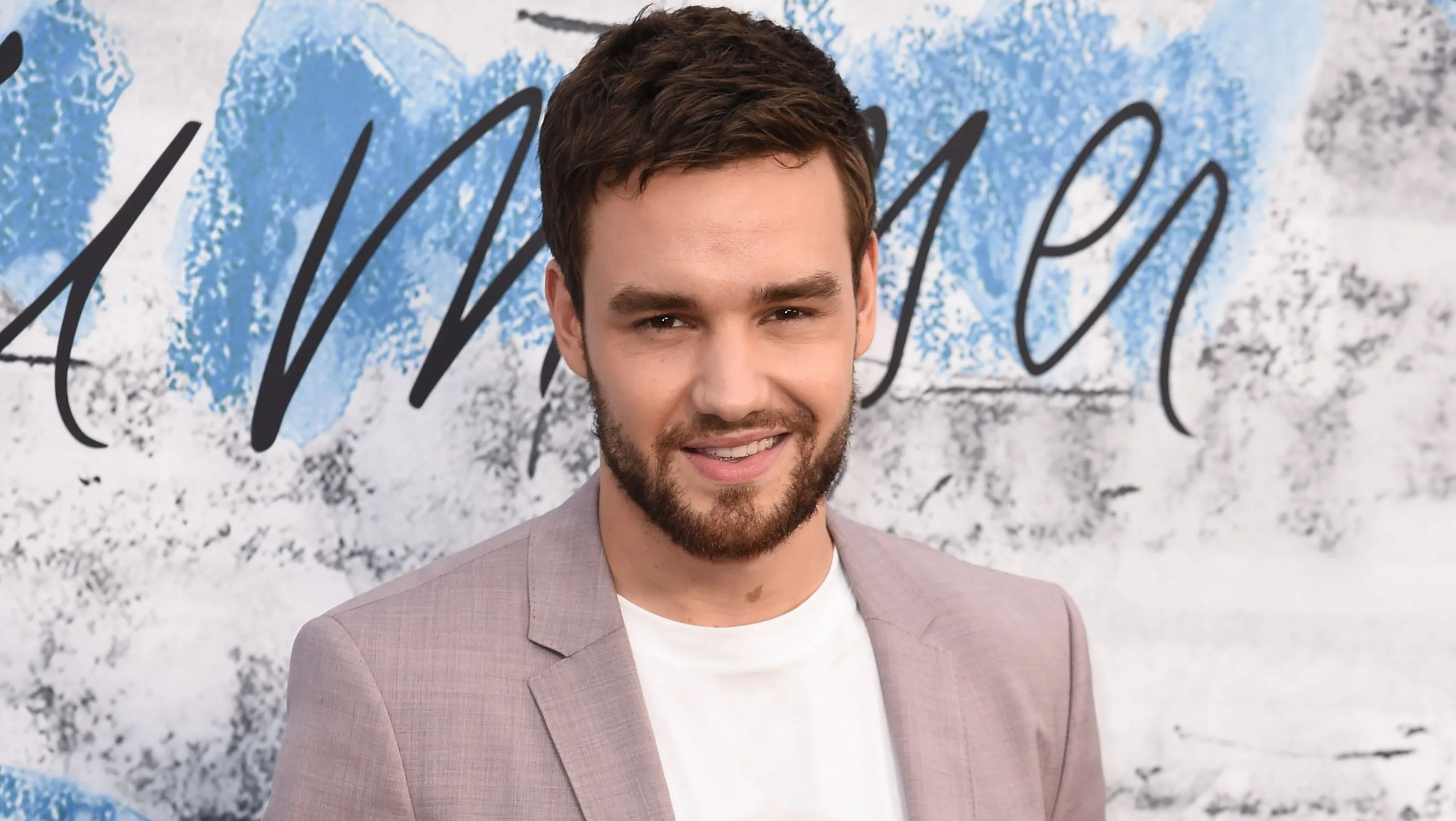 Liam Payne in a light pink suit