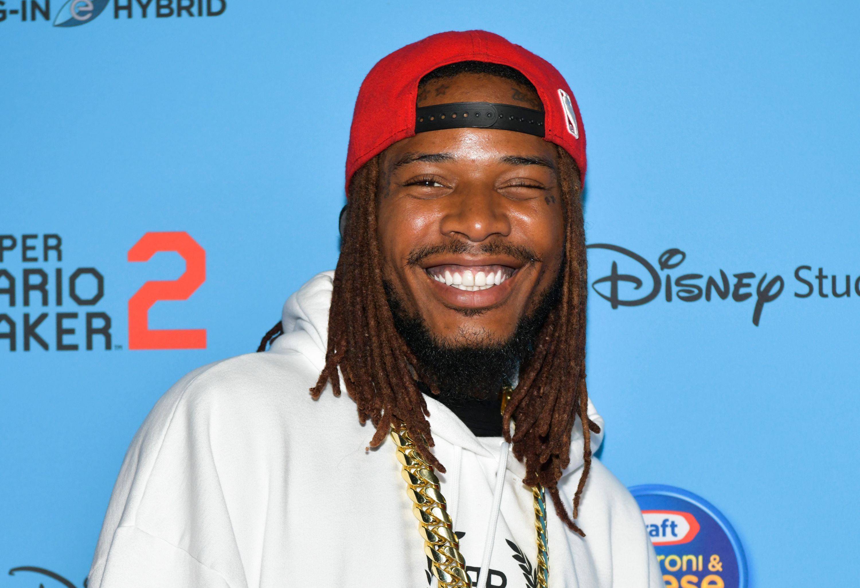 Fetty Wap looks amazing in this photo as he is all smiles at an event.