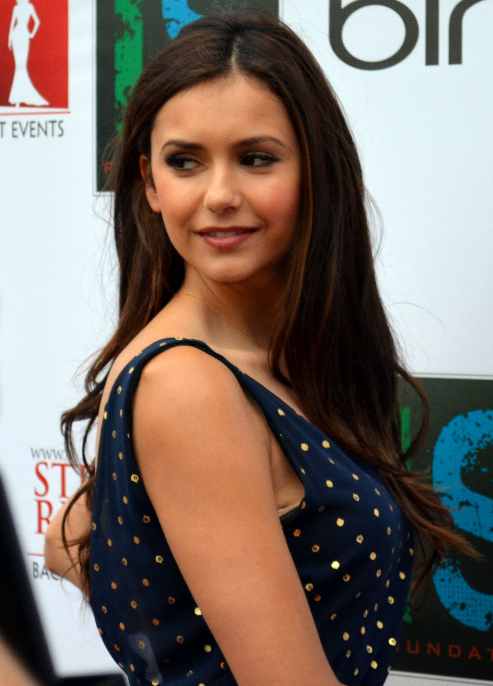 Nina Dobrev looks breath-taking in this photo as she gives a shy smile.