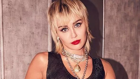 Miley Cyrus close up in a black top