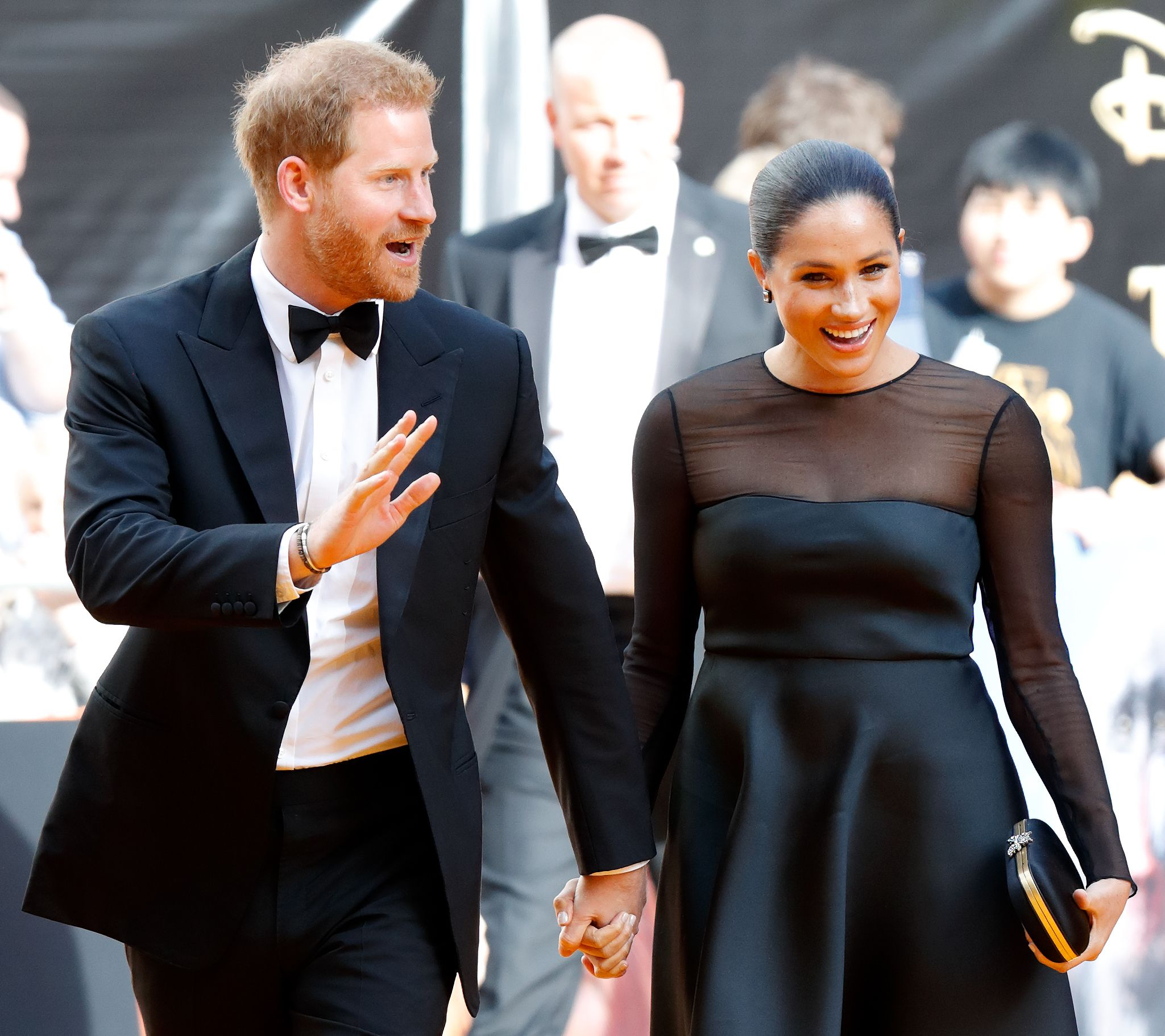 Prince Harry and Meghan Markle walking the red carpet at a movie premiere