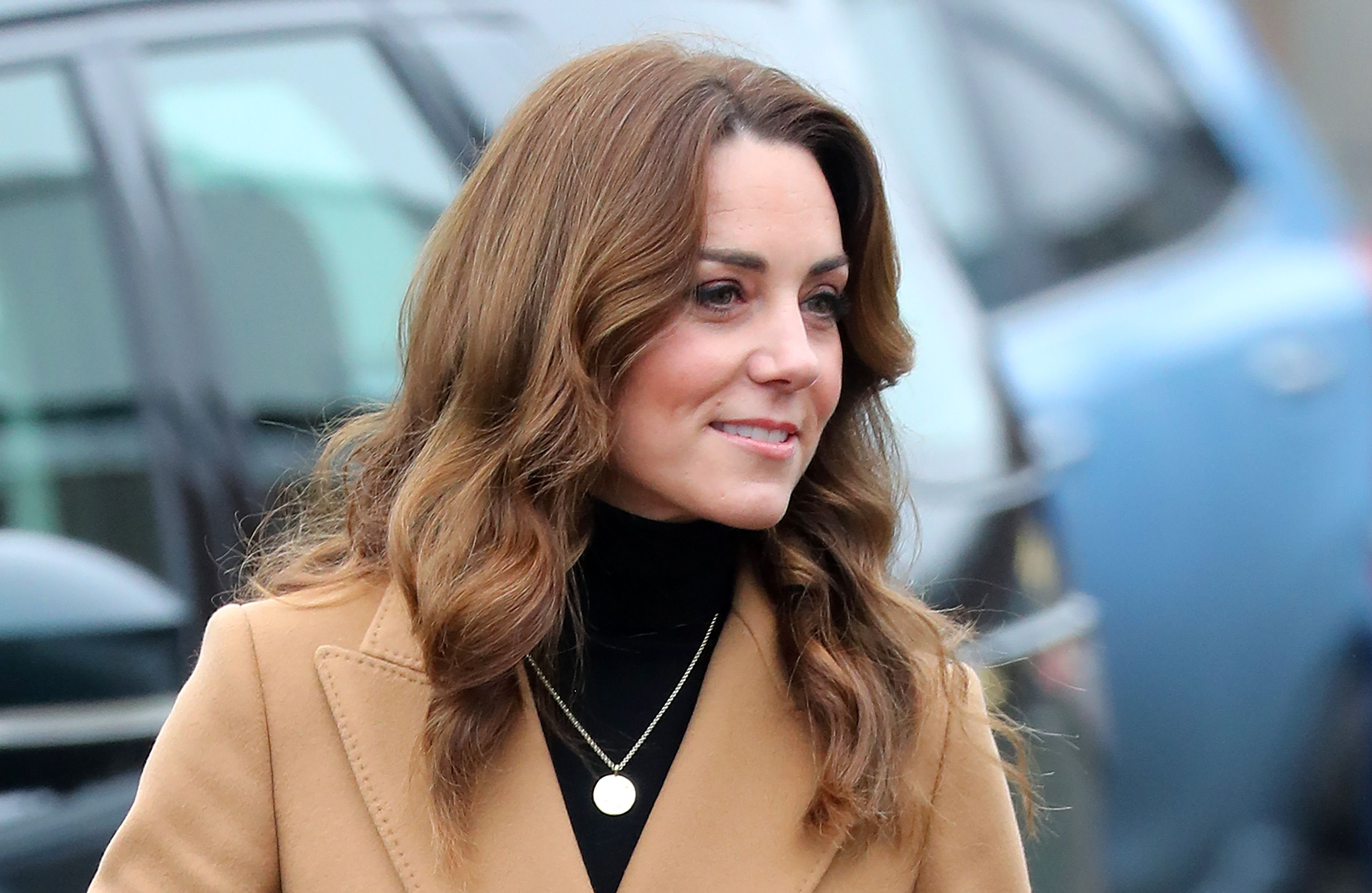 The Duchess of Cambridge in a black turtleneck and tan coat