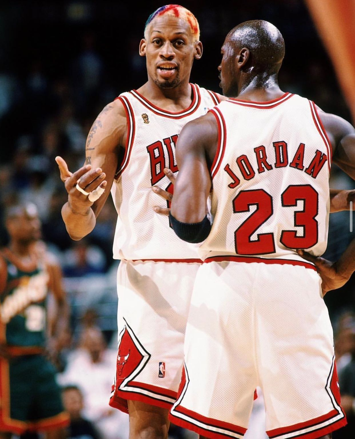 Michael Jordan and Dennis Rodman playing basketball for the Chicago Bulls