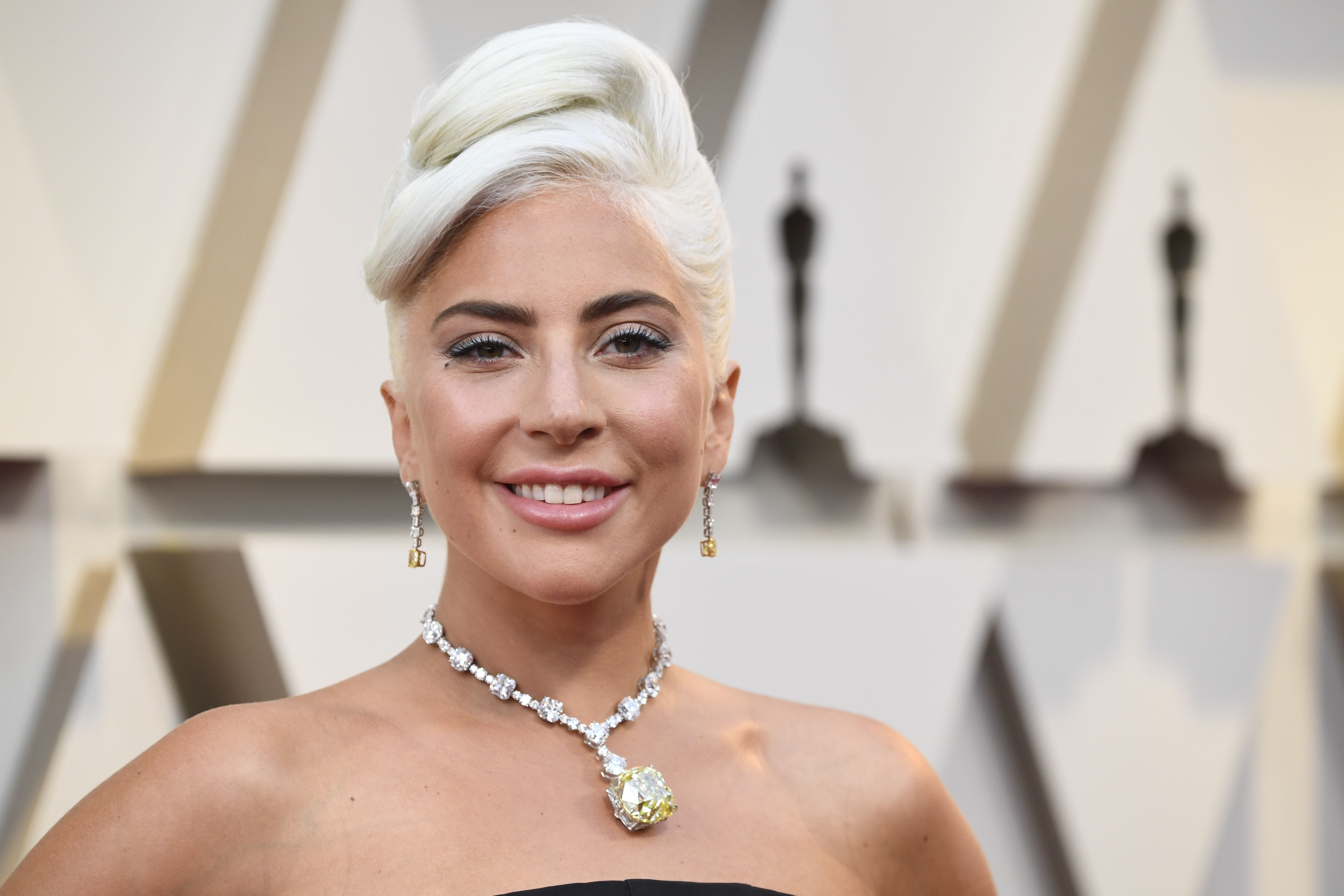 Lady GaGa poses for a photo on the red carpet.