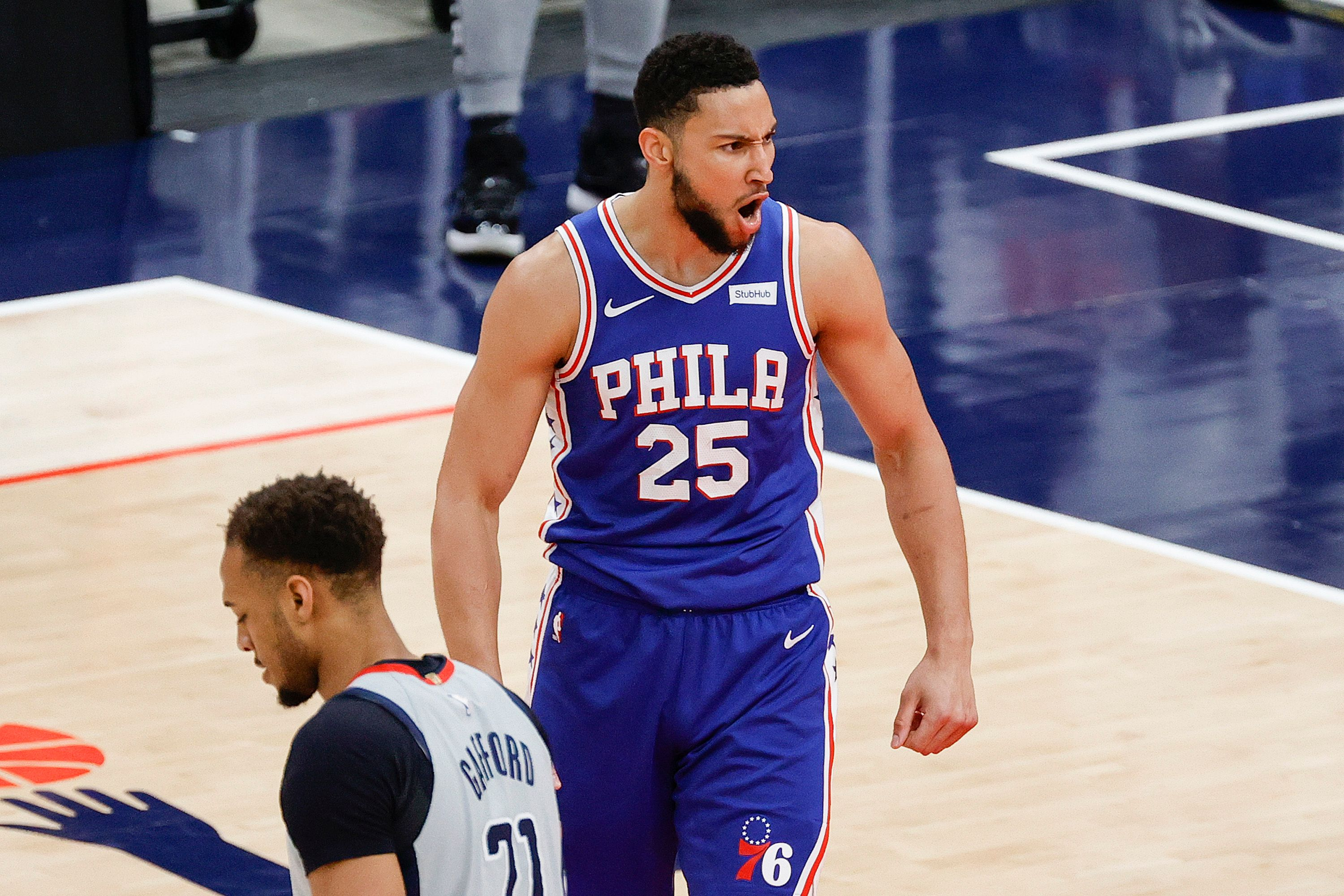 Ben Simmons screams after dunking the ball
