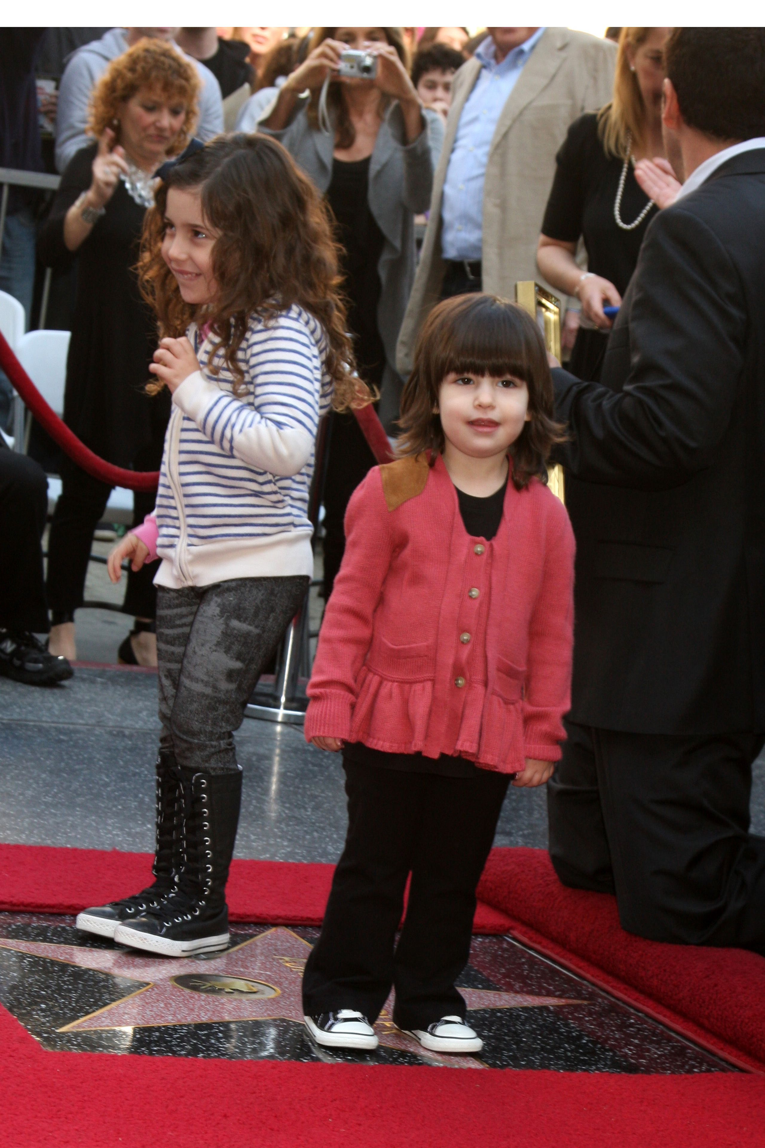 Sadie and Sunny Sandler stand on dad's star on the Hollywood Walk of Fame.