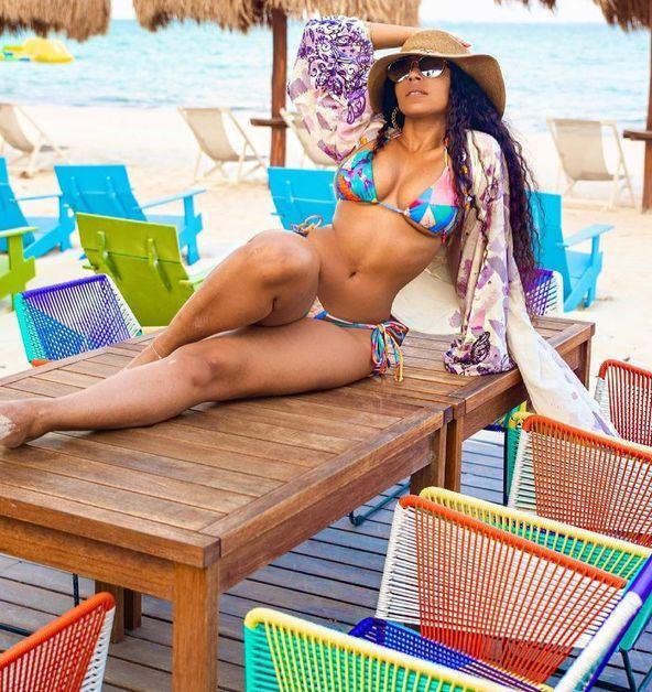 Ashanti stretches out in a colorful bikini.