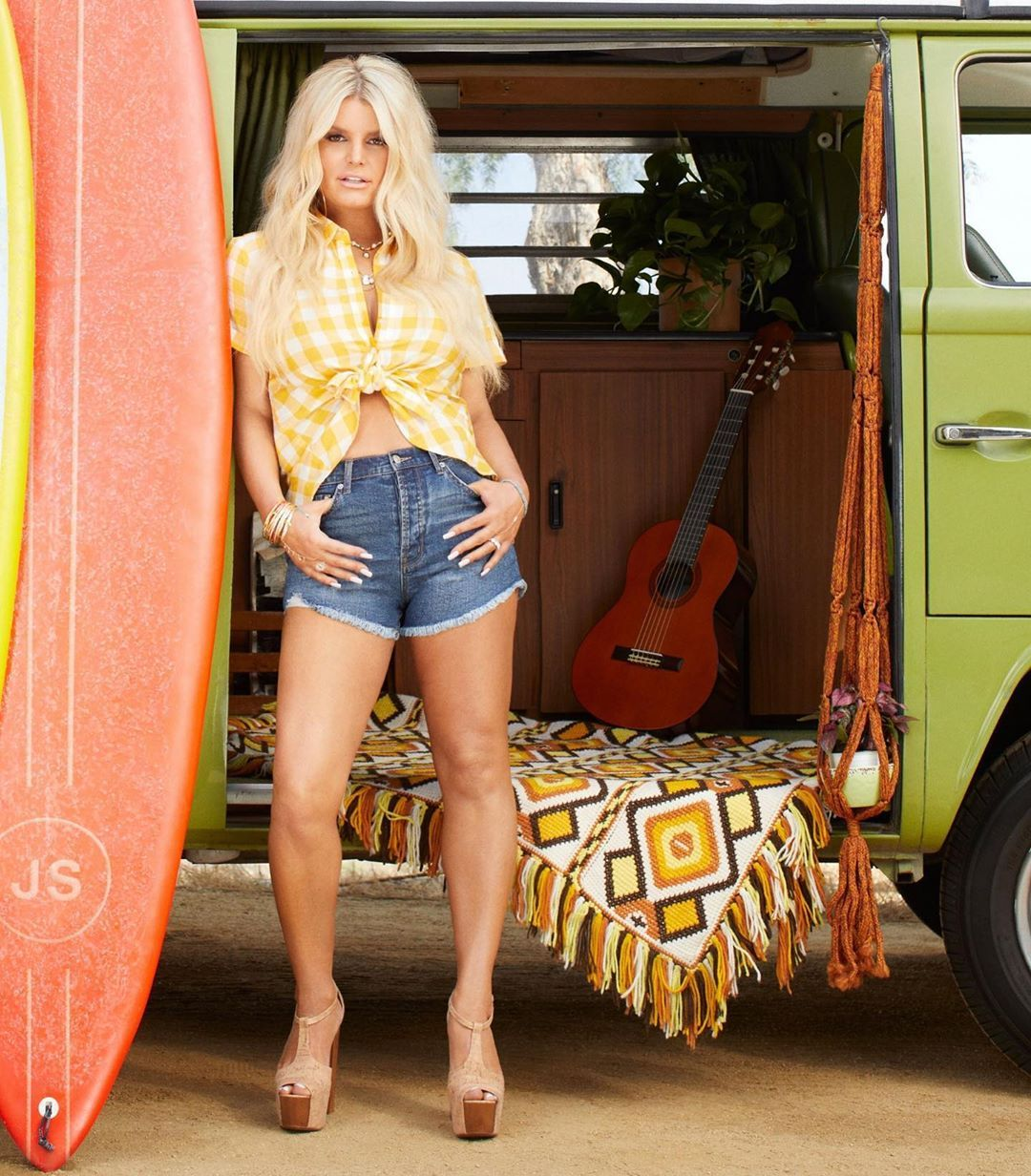 Jessica Simpson in shorts by an RV