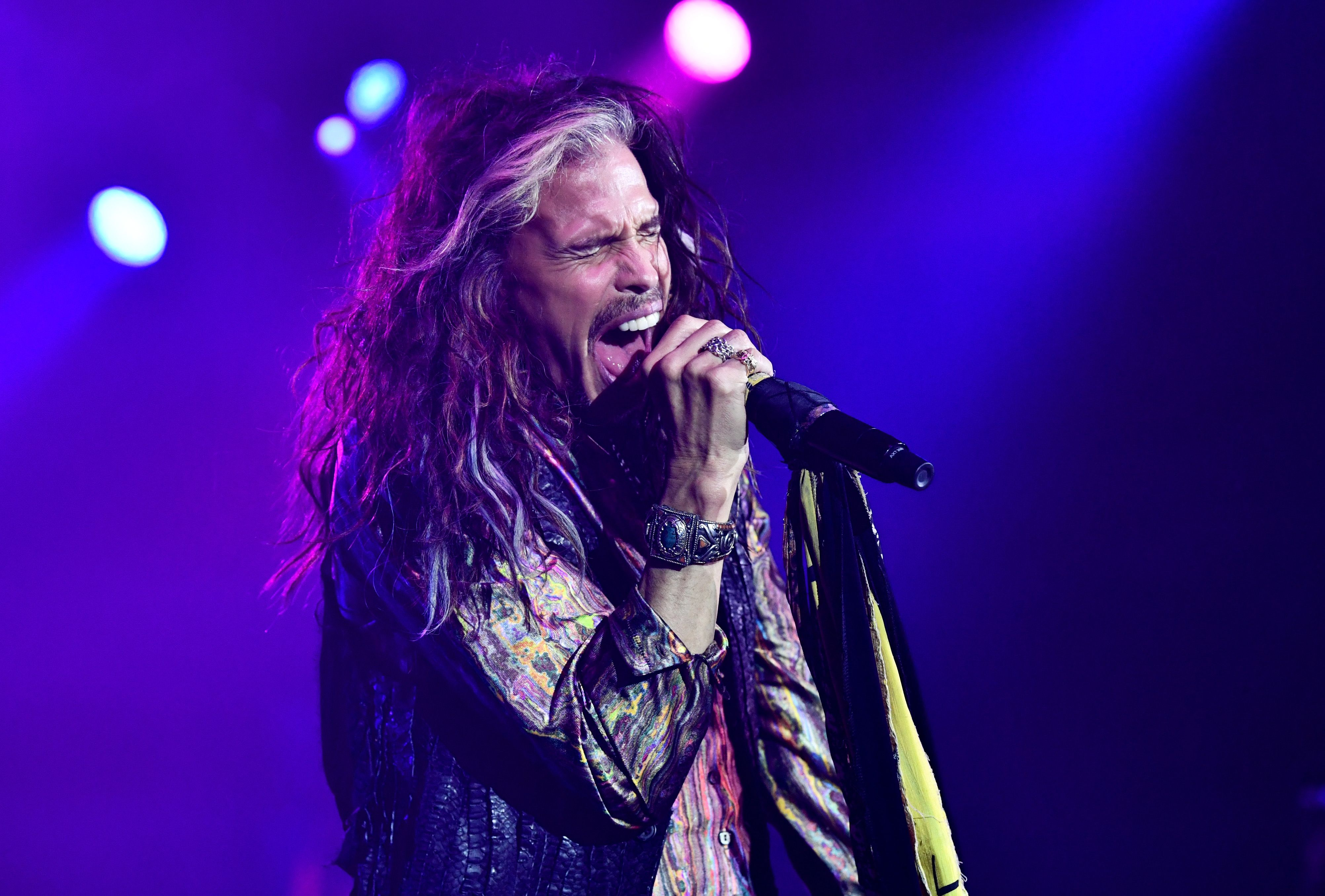 Steven Tyler singing at a show.