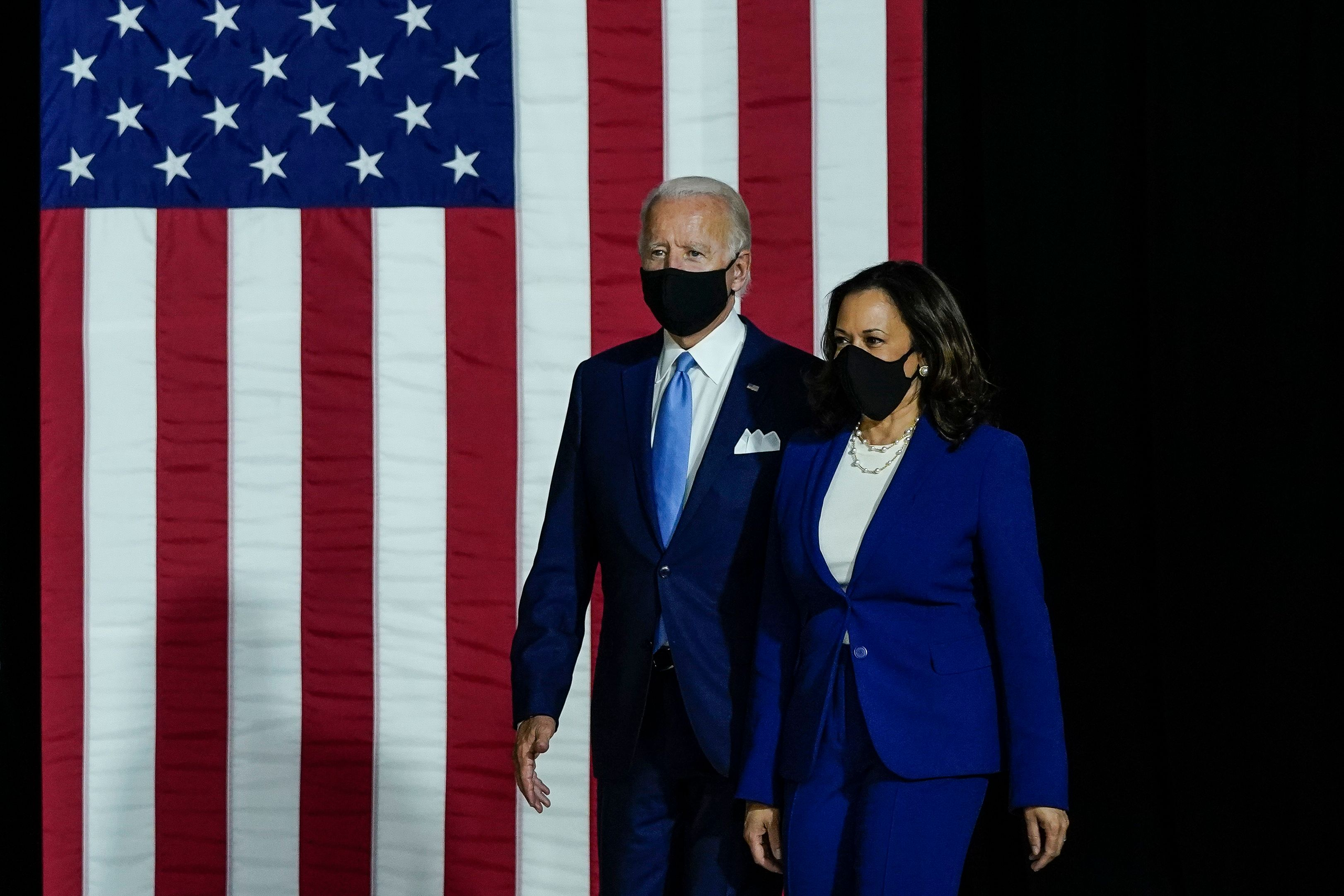 Joe Biden and Kamala Harris in front of an American flag.