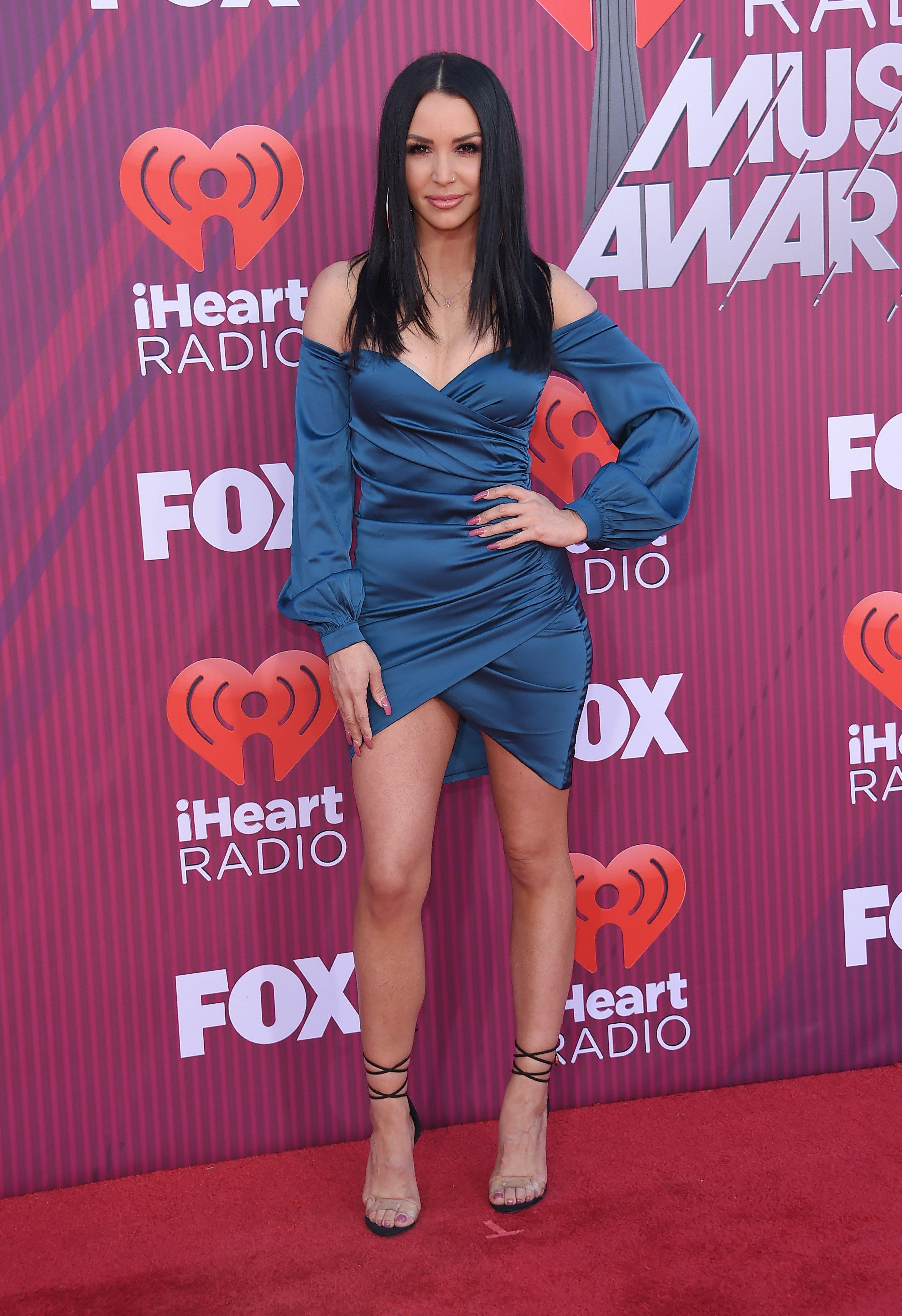 Scheana Shay wears a blue wrap dress.
