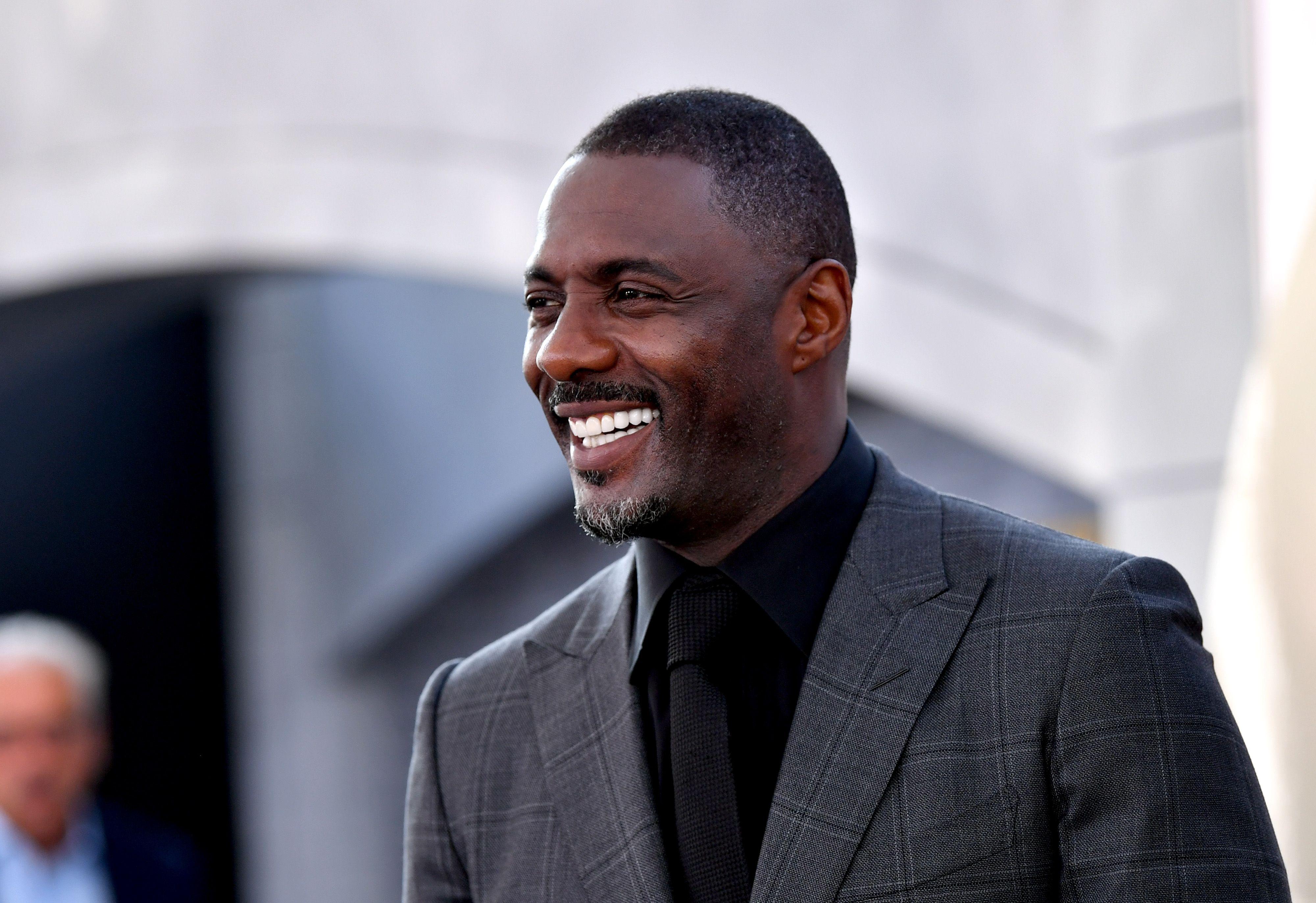 Idris Elba poses for a photo.