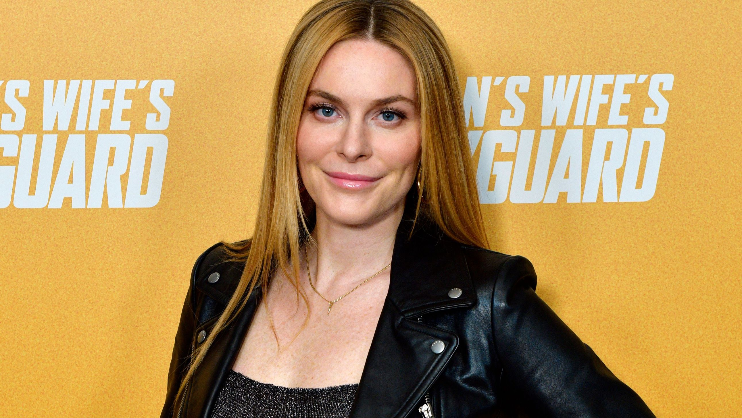 Leah McSweeney wears her hair down with a leather jacket.