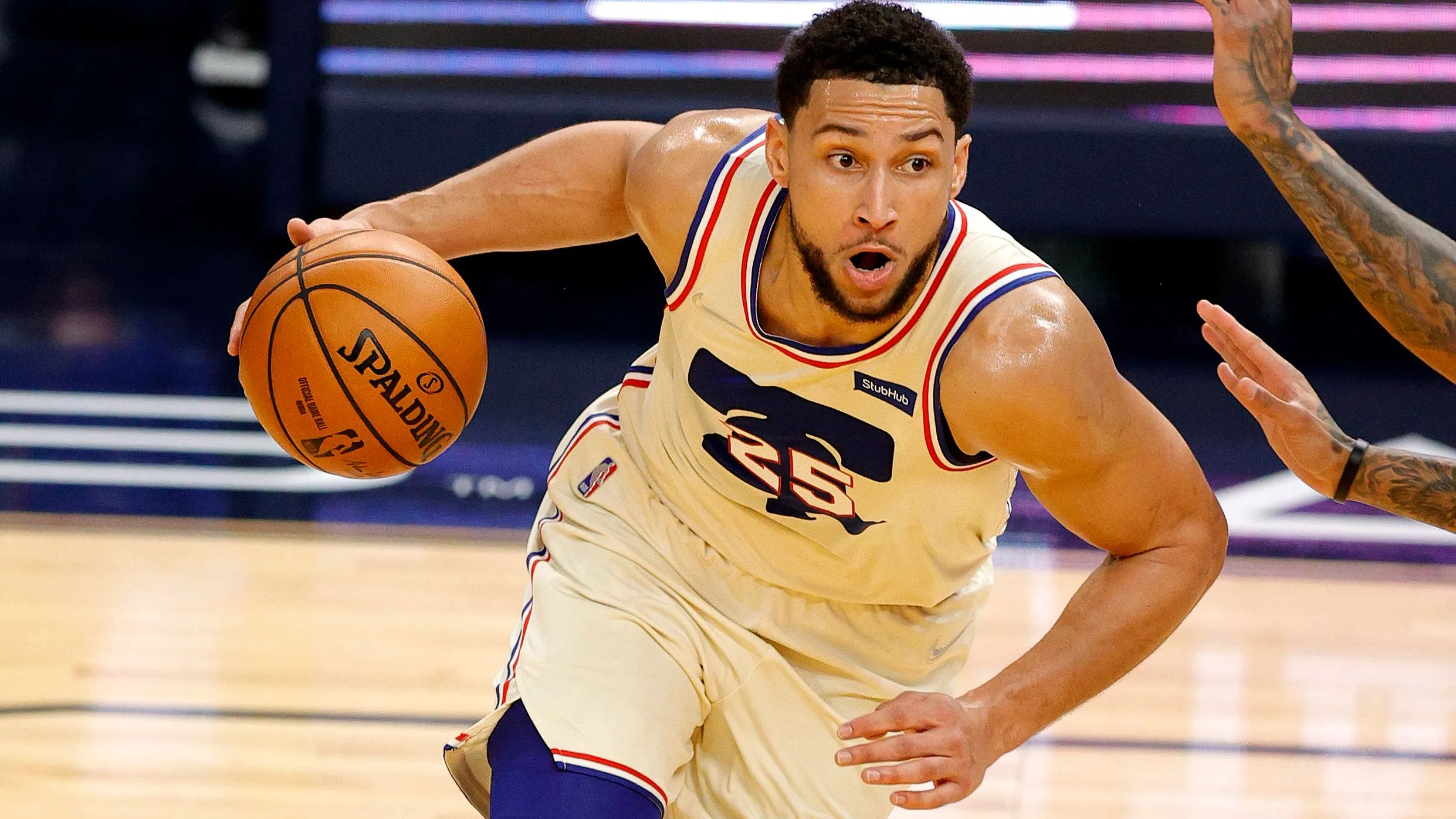 Ben Simmons driving into the basket