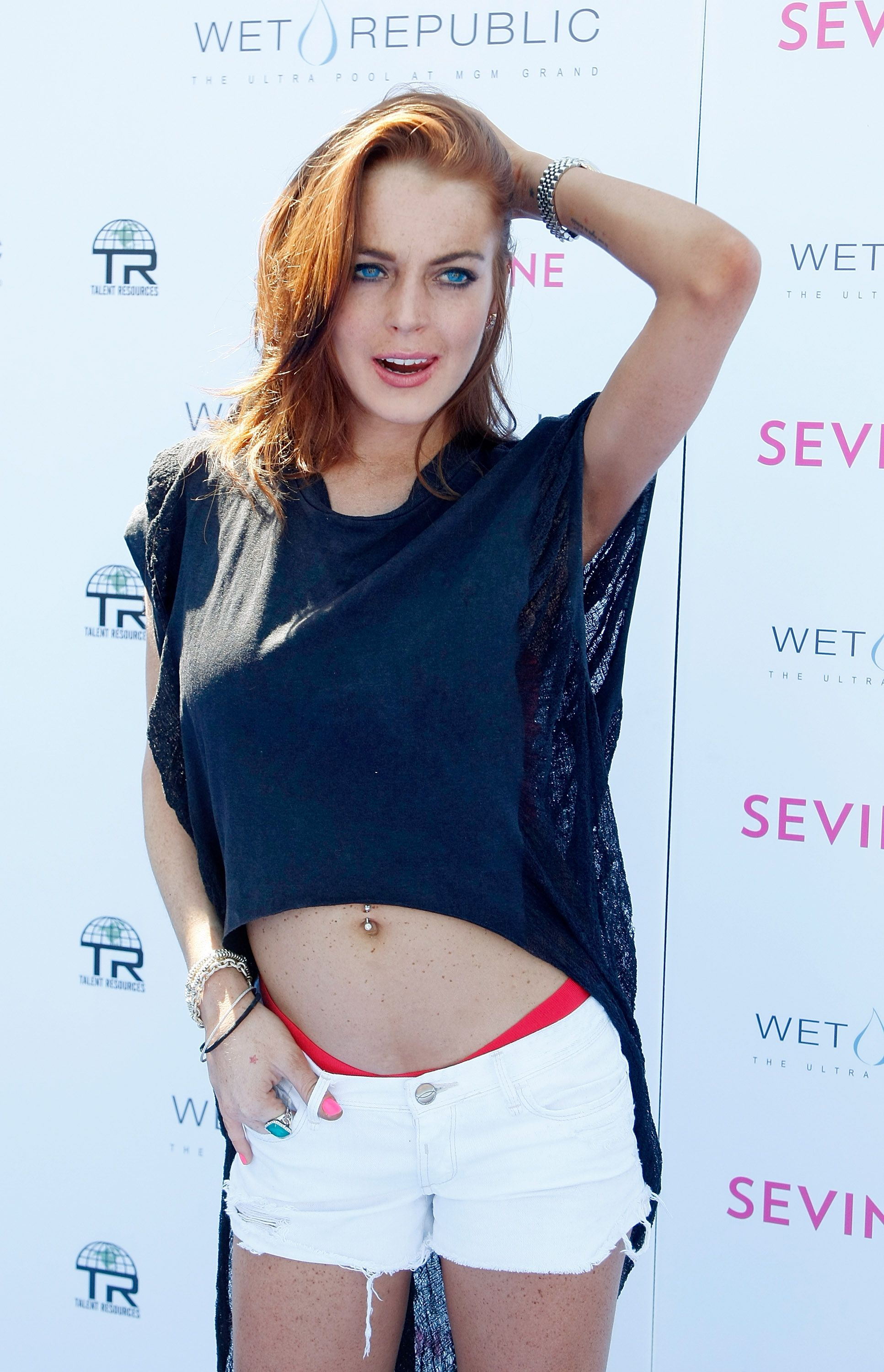 Lindsay Lohan wearing white shorts and blue top
