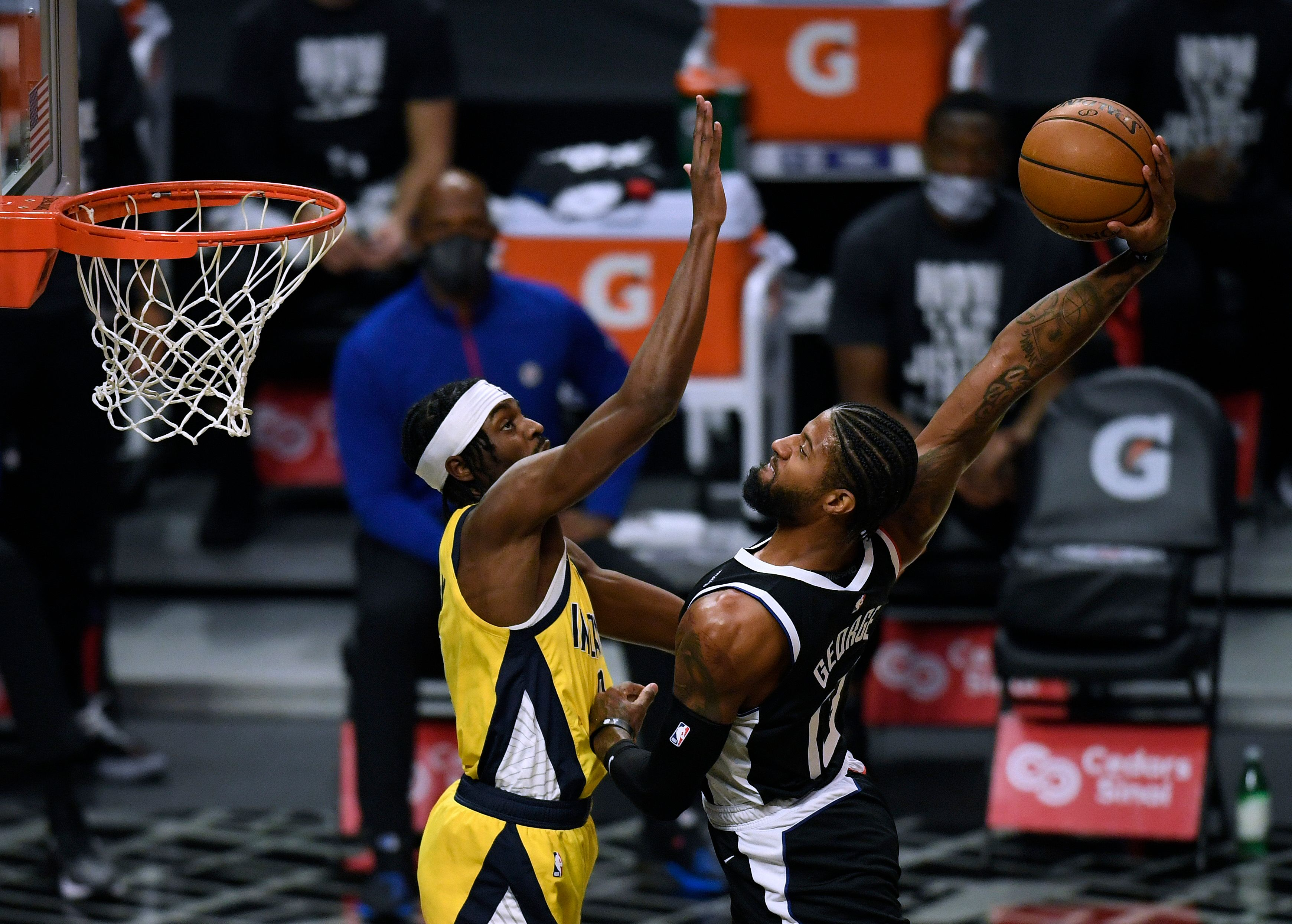 Paul George dunking the ball