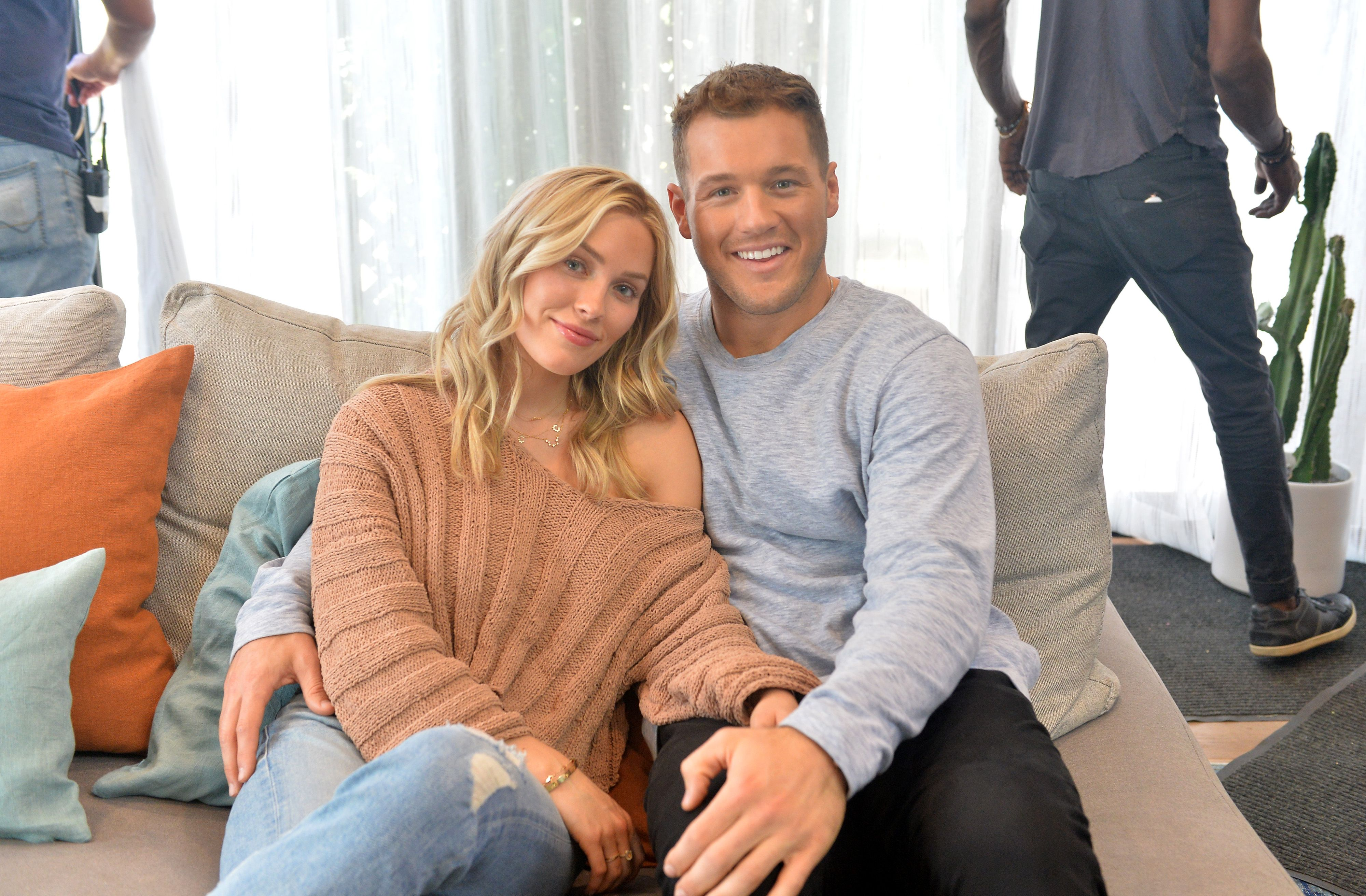 Cassie Randolph and Colton Underwood sitting on a couch