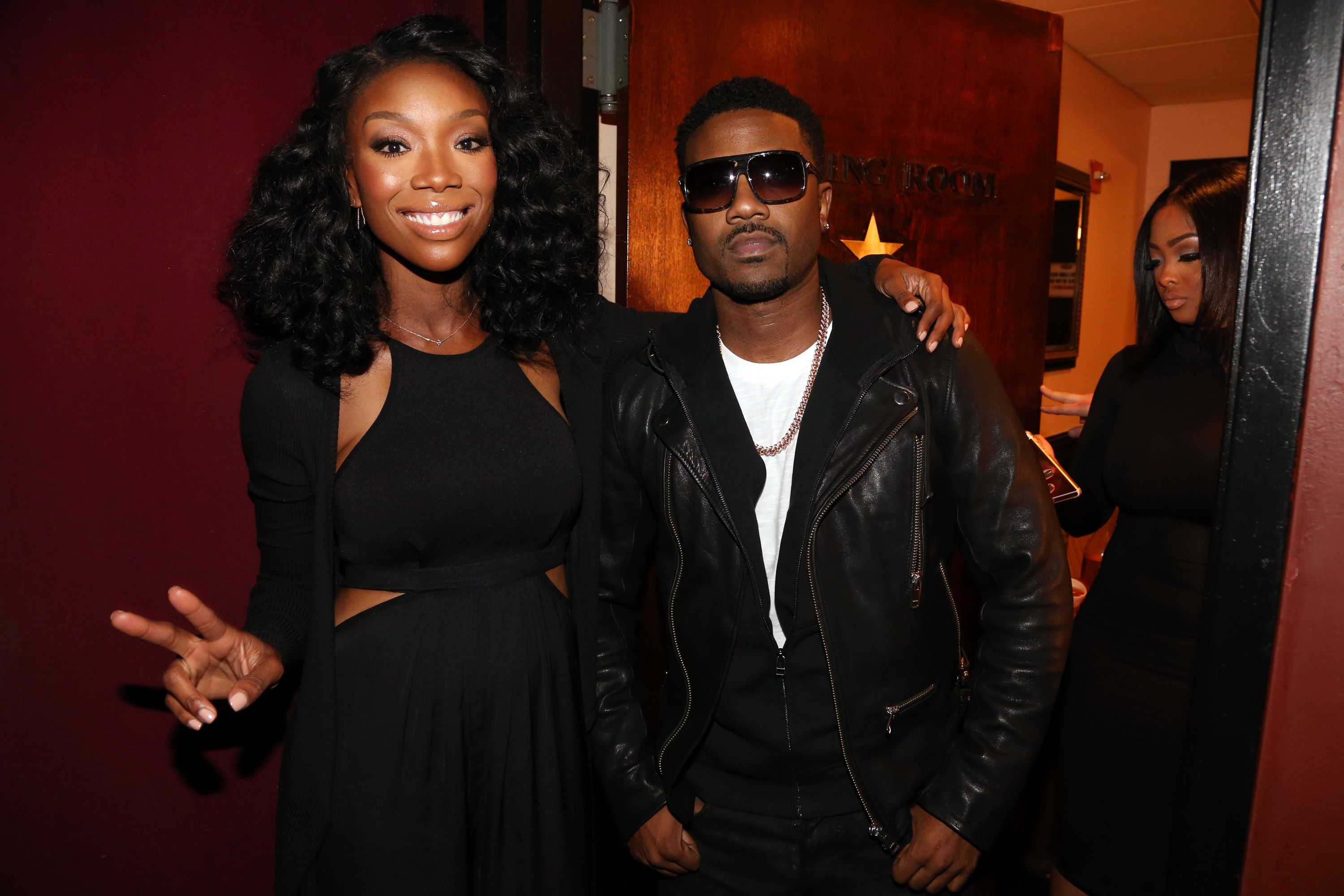 Brandy and Ray J Norwood with Princess Love in the background